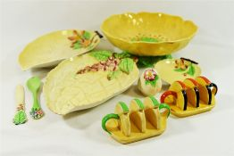 A quantity of Carlton Ware comprised of two toast racks, a butter knife and conserve spoon,