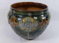 A Royal Doulton pottery jardinere, with scroll and stylised floral tube lined decoration,