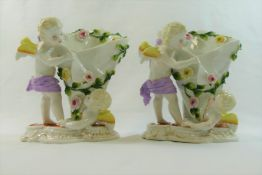 A pair of 19th century Continental porcelain figural vases,