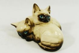 A Royal Doulton cat group of two Siamese kittens,