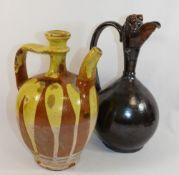 A Turkish Canakkale pottery brown glazed ewer, 32cm high,