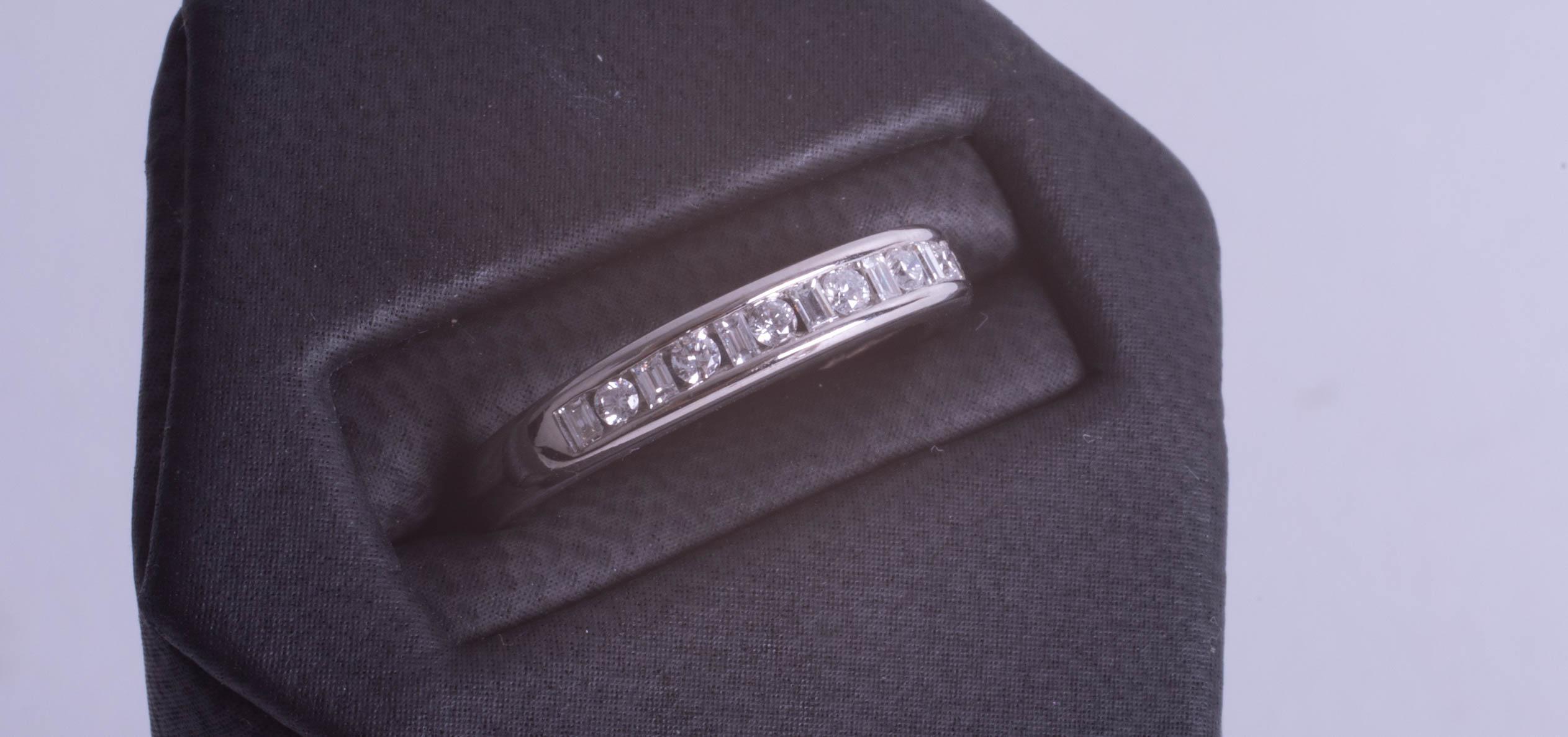 Lot 093 - A modern 18ct white gold diamond set eternity ring, size M.