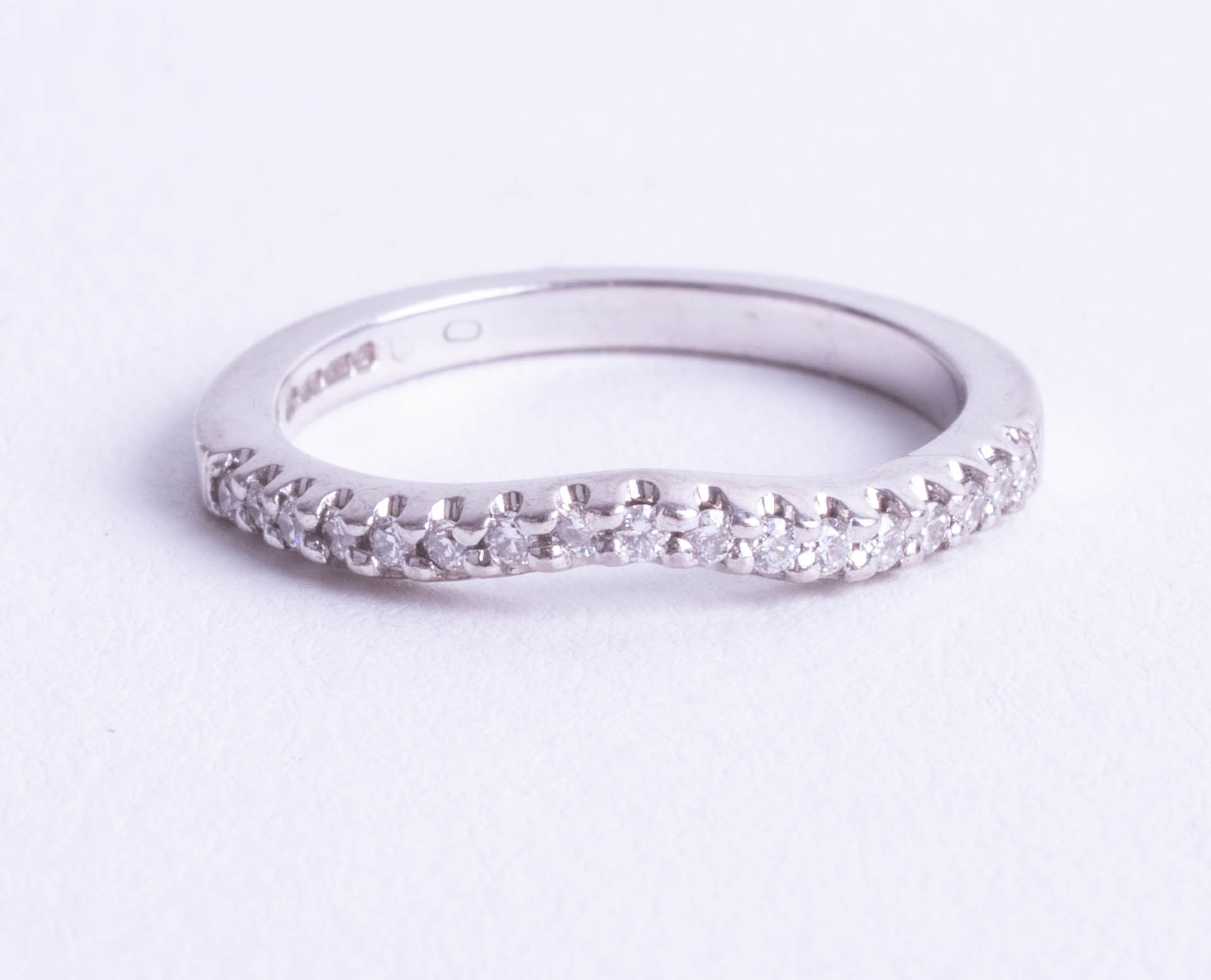 Lot 109 - An 18ct white gold 17 stone diamond set half eternity ring, total combined weight 0.17ct, with