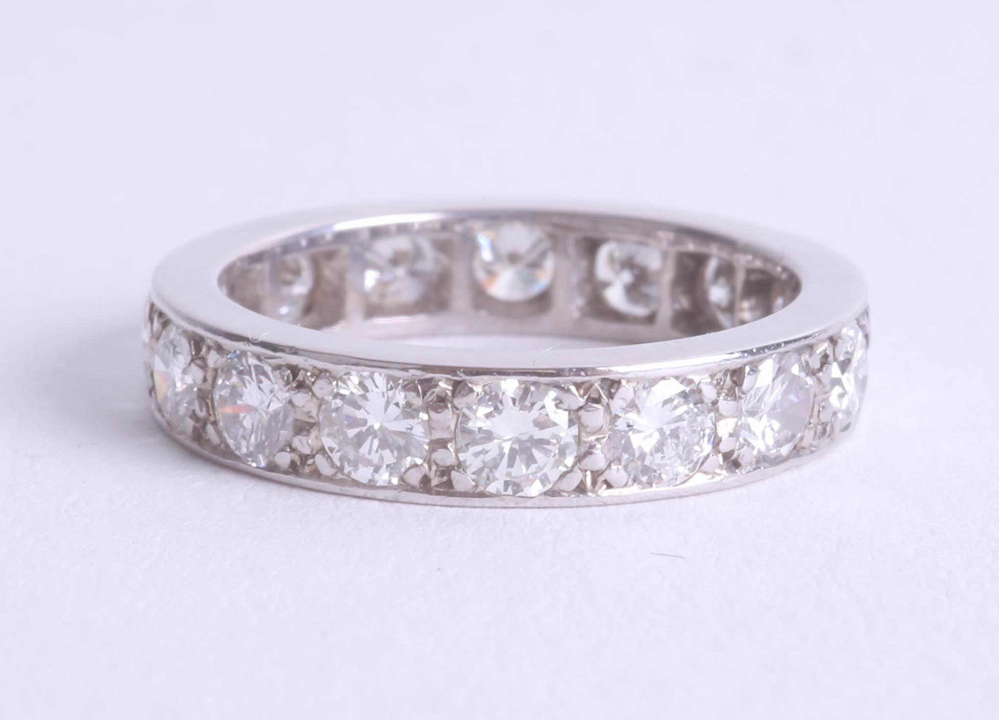 Lot 106 - A diamond full band eternity ring probably platinum, size I.