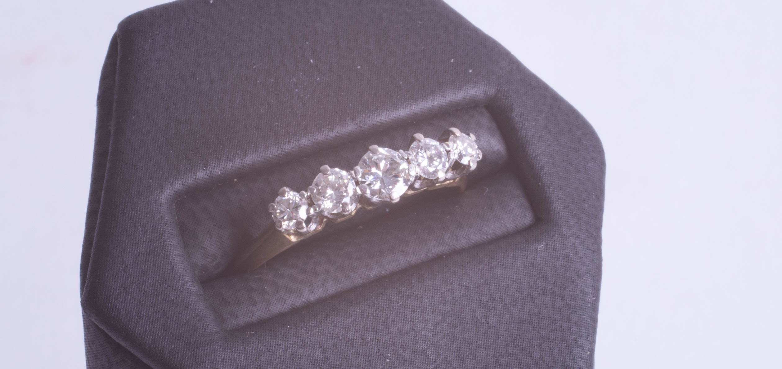 Lot 068 - An 18ct diamond set five stone ring approx. 0.50ct, size Q.