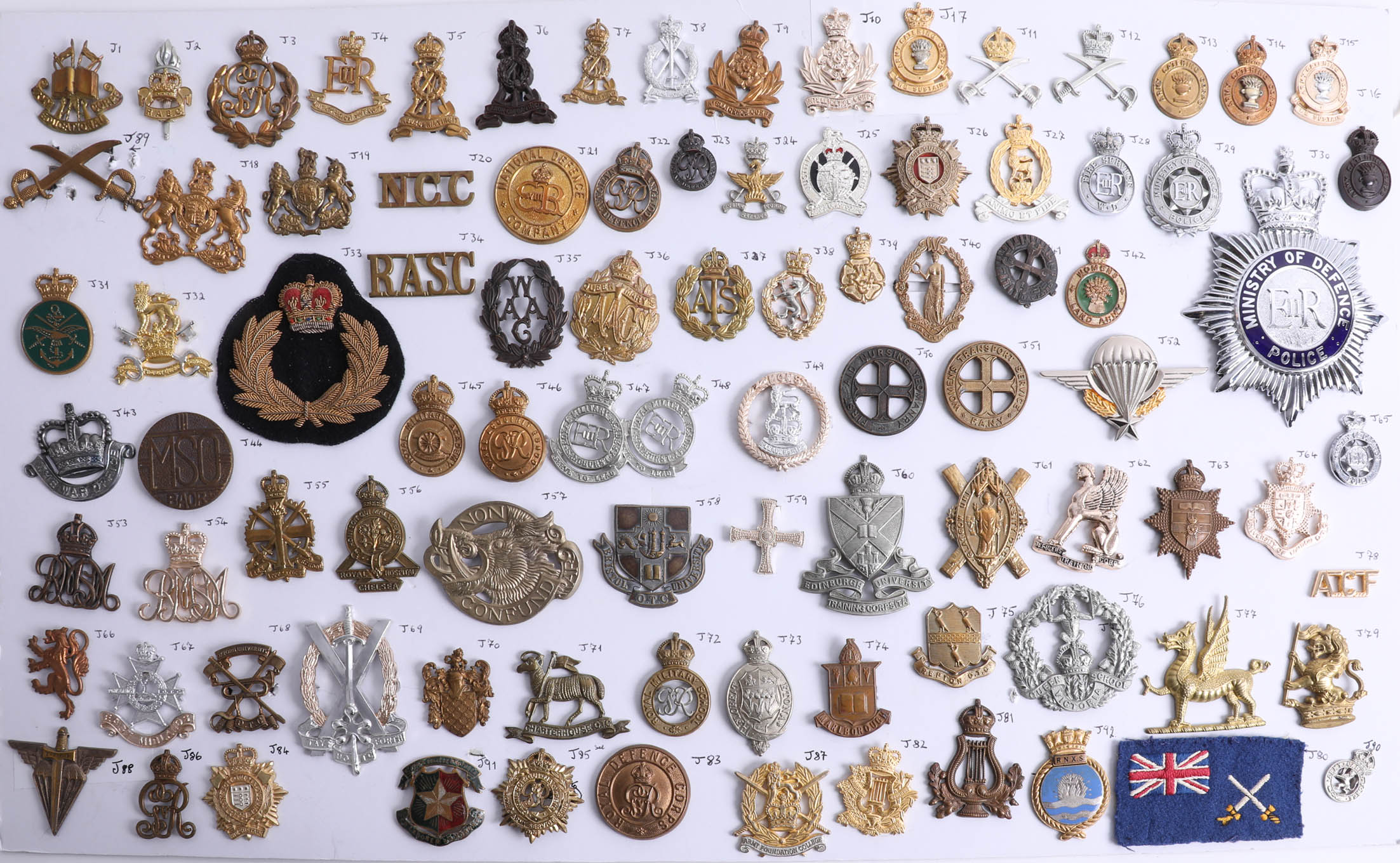 Lot 010 - A collection of approx. 92 military cap badges including those of the Intelligence Corps, Pioneer