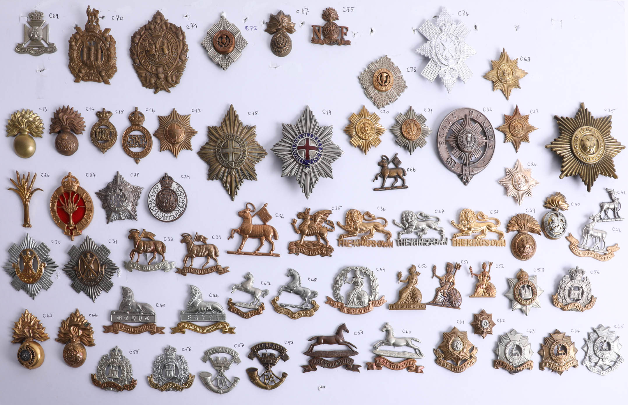 Lot 003 - A collection of approx. 63 military cap badges including Grenadier, Coldstream, Irish, Scots and