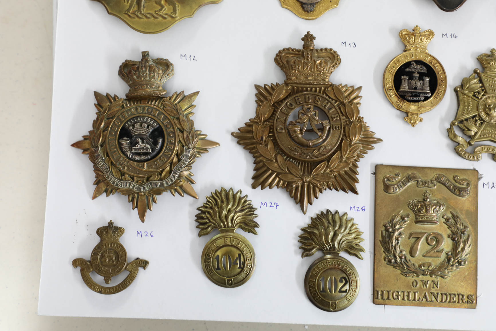 Lot 013 - A collection of approx. 28 military cap badges mostly 19th century including a Standard British Army