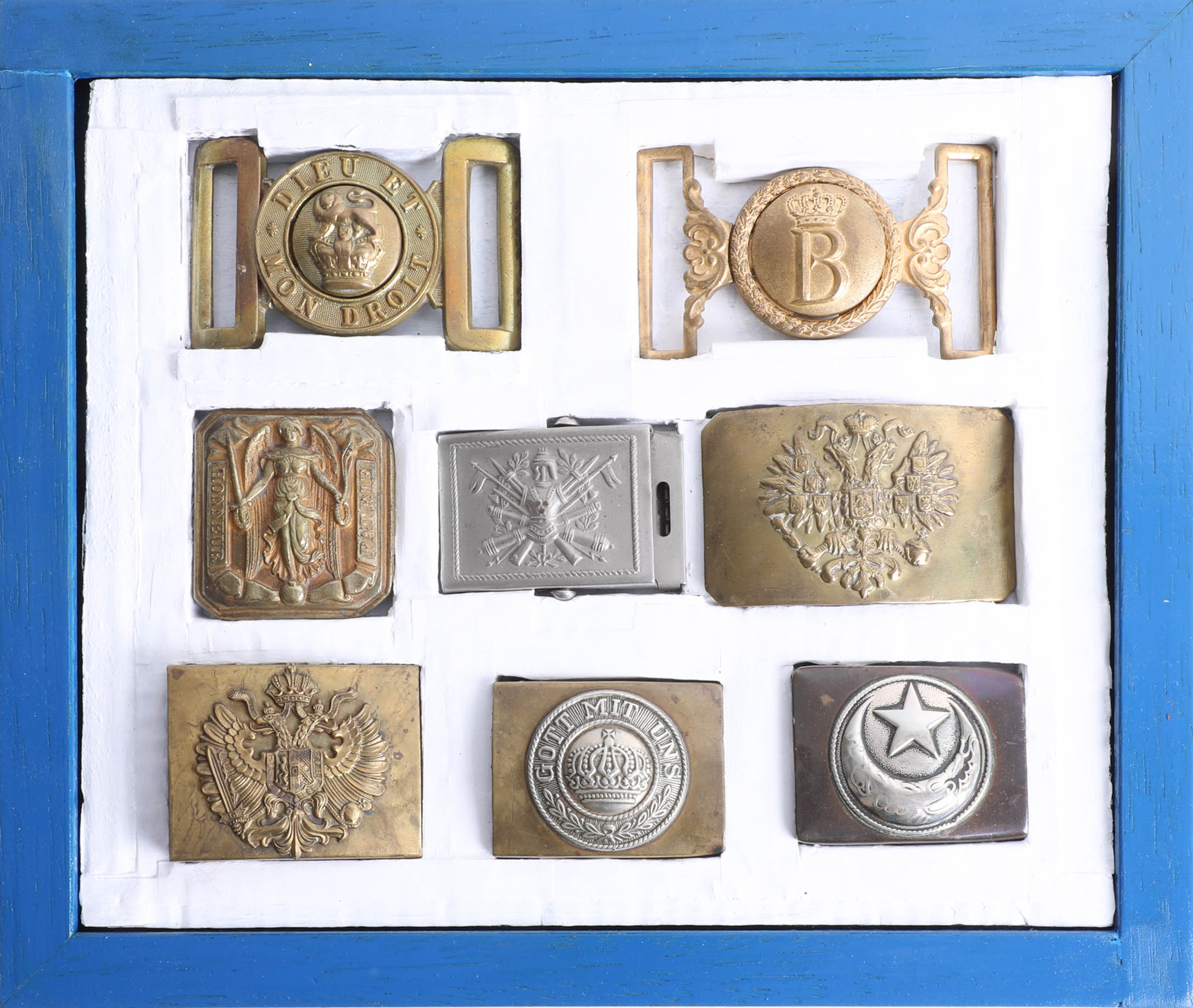 Lot 038 - Eight military belt buckles including Russian and French. Part of the Late Reverend Geoffrey