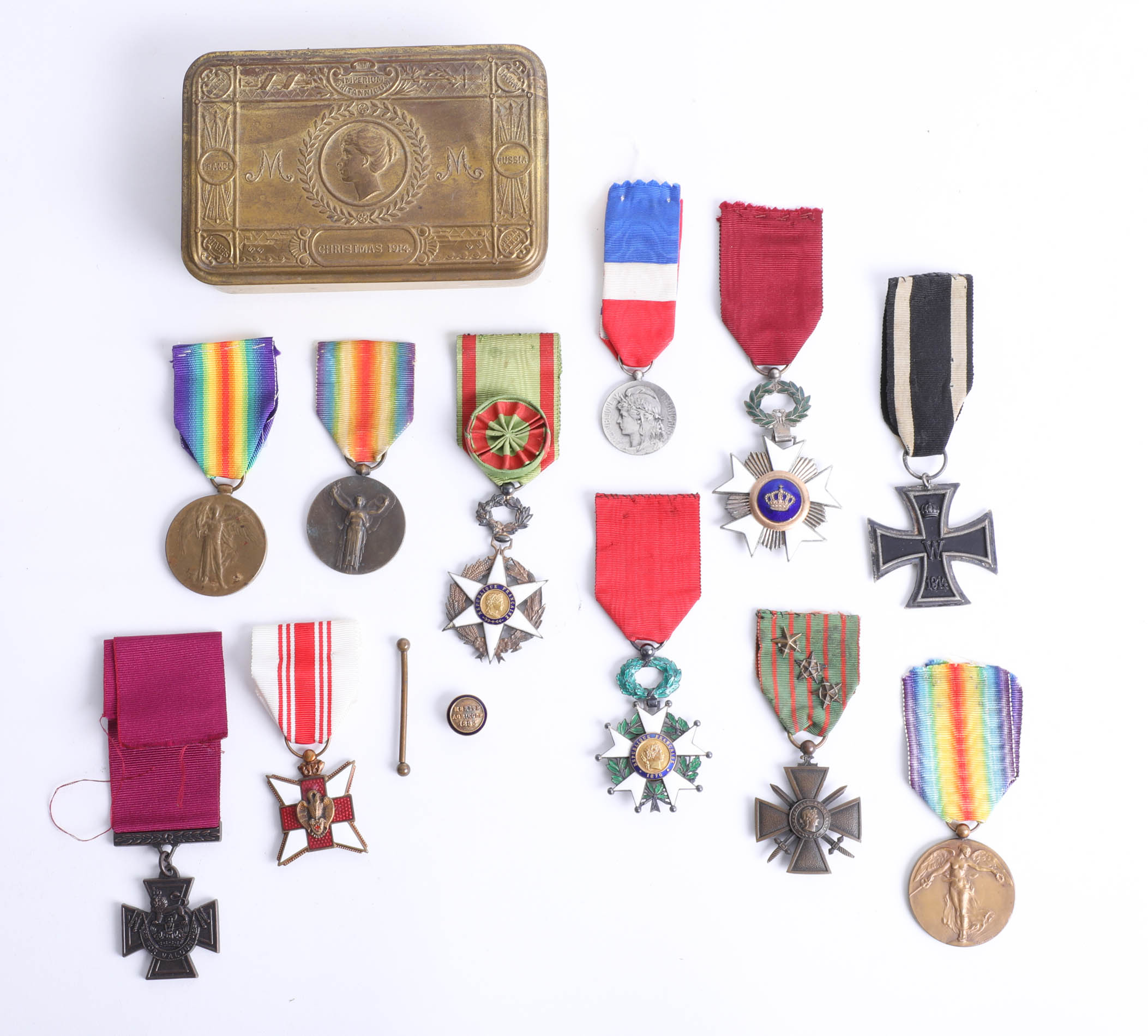 Lot 025 - A Great War Christmas 1914 'Mary' tin containing various medals (some replicas) including enamel