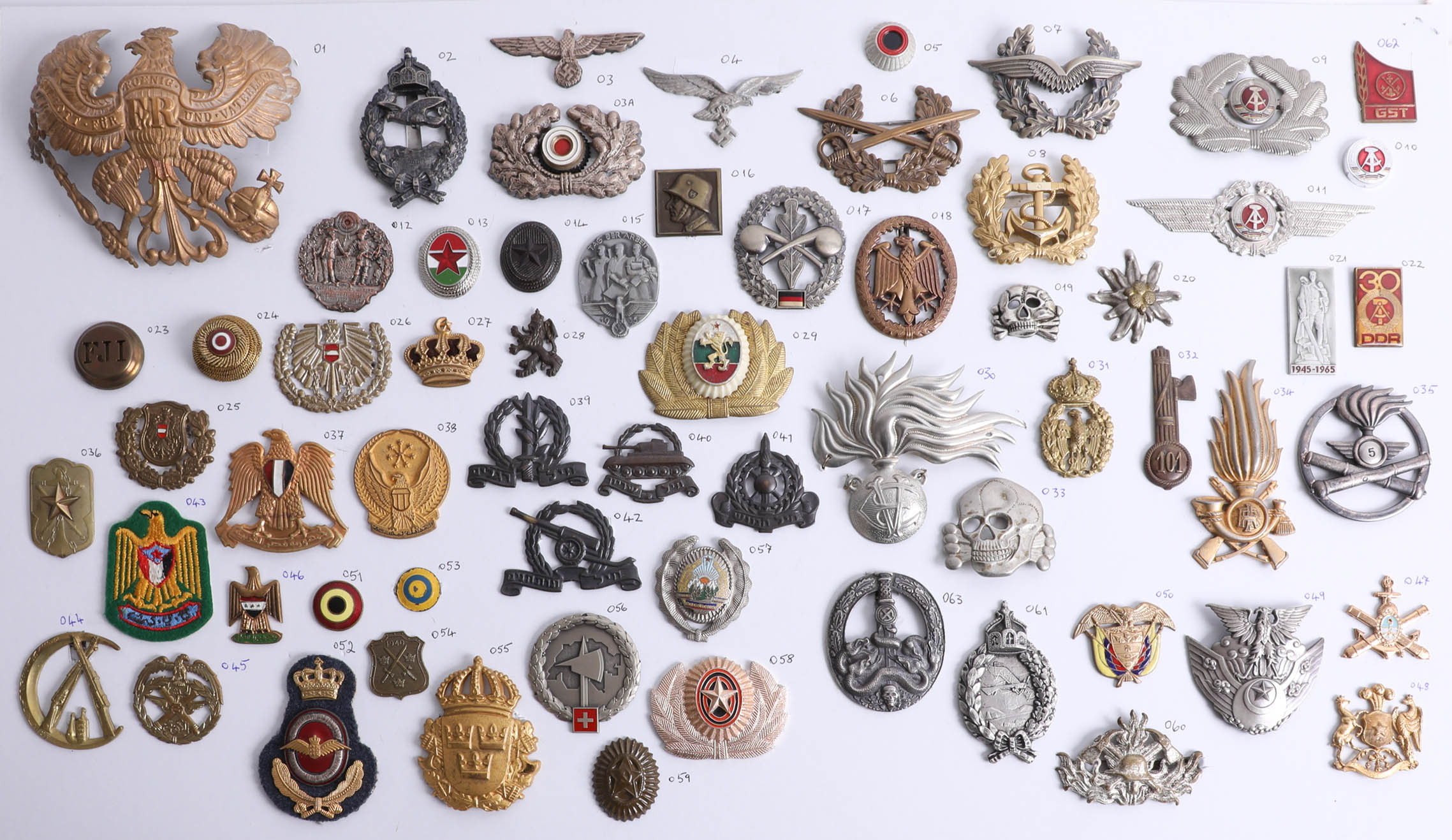 Lot 017 - A collection of approx. 52 miscellaneous interesting and decorative military cap and other badges