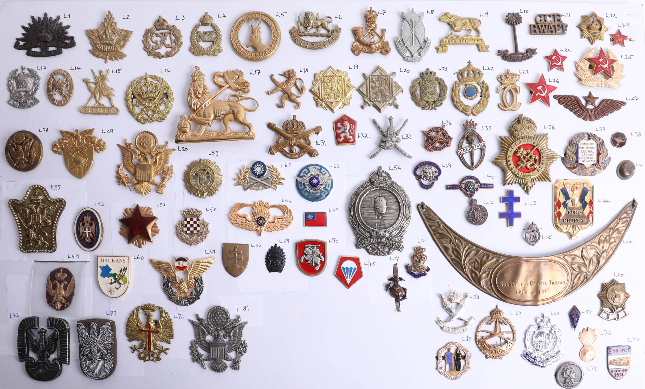 Lot 012 - A collection of approx. 75 military cap and other badges of foreign and overseas forces including