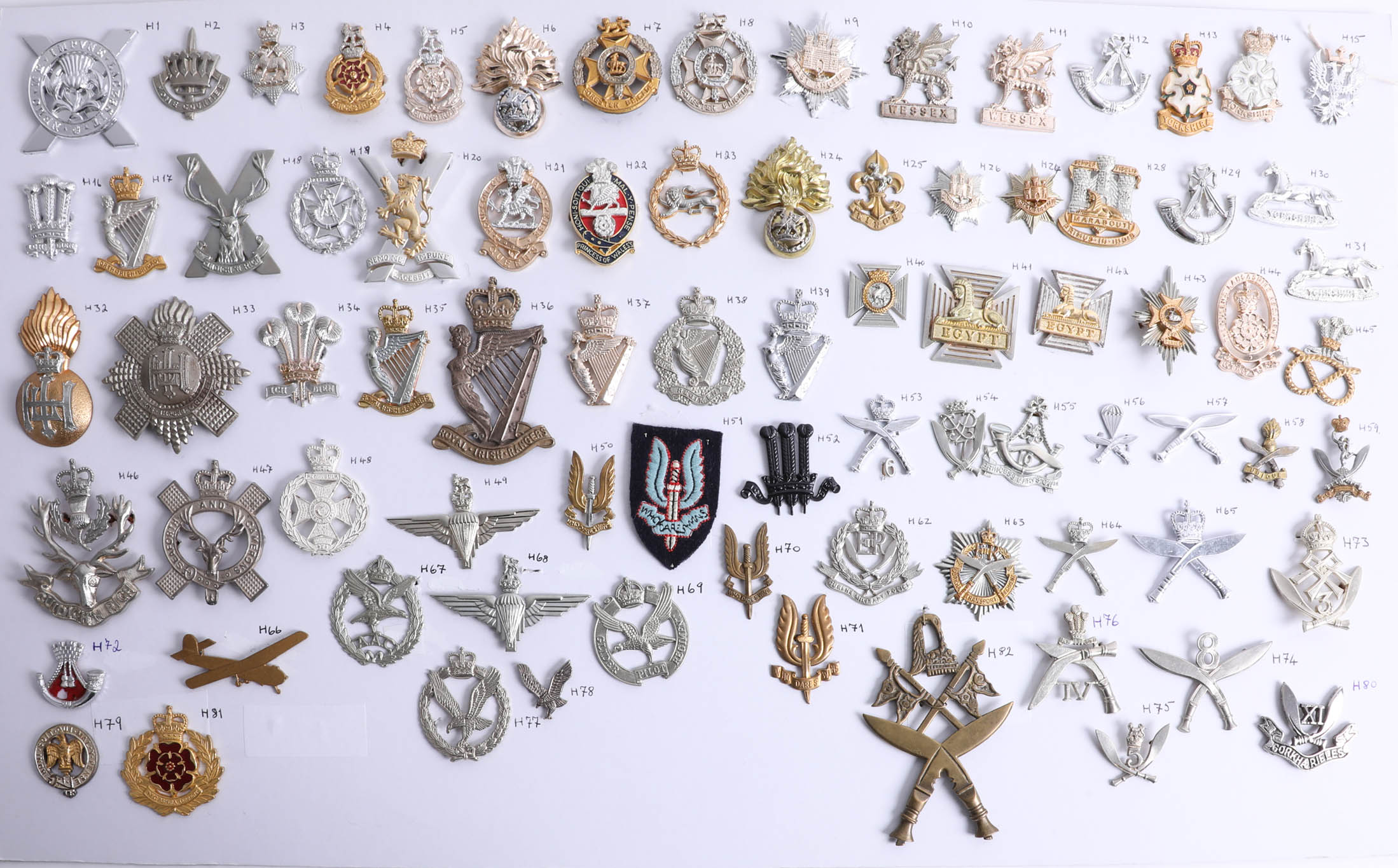 Lot 008 - A collection of approx. 80 military cap badges including SAS, Glider Pilot Regiment and many