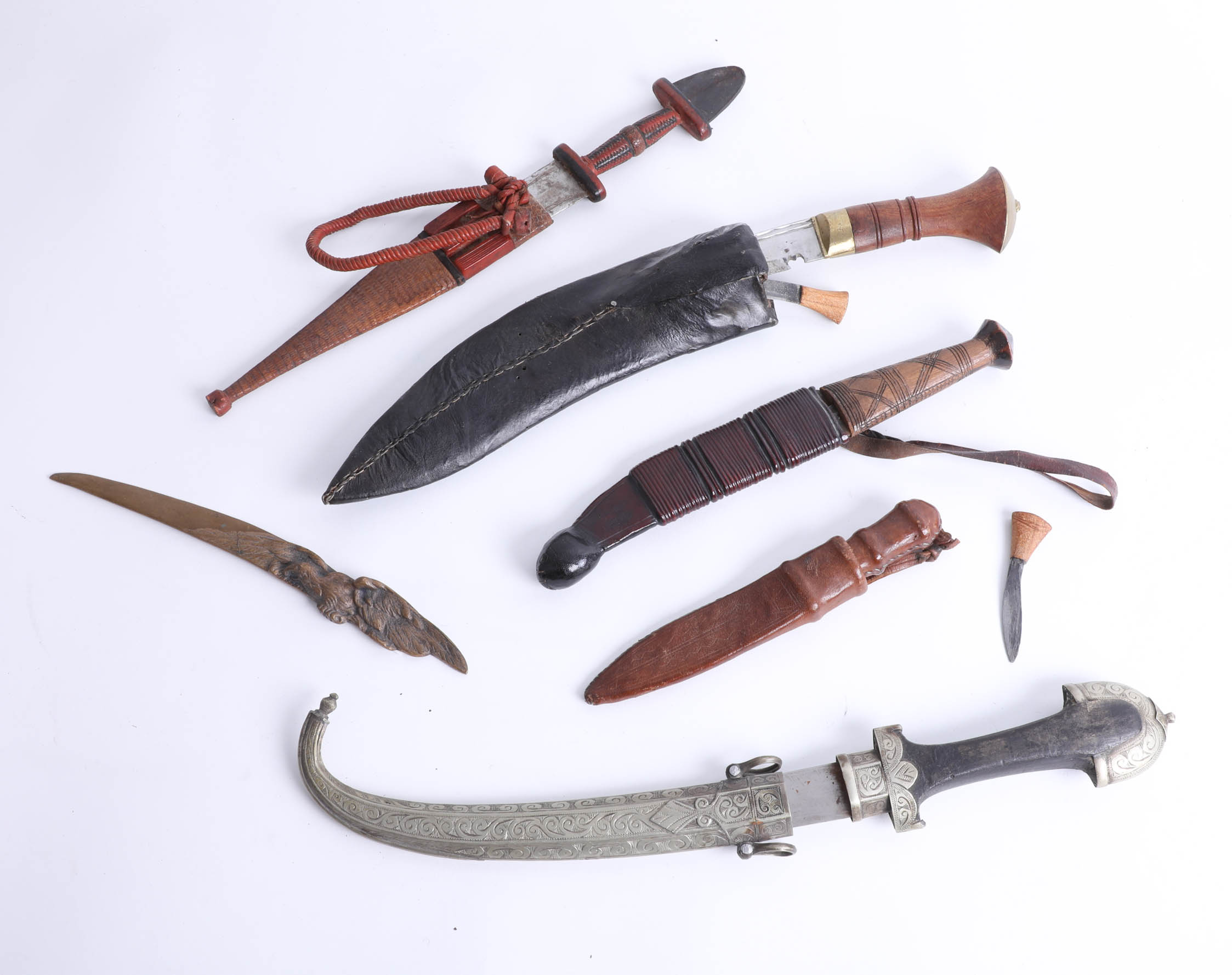 Lot 036 - Five various knives including a kukri, a middle eastern short knife and daggers. Part of the Late