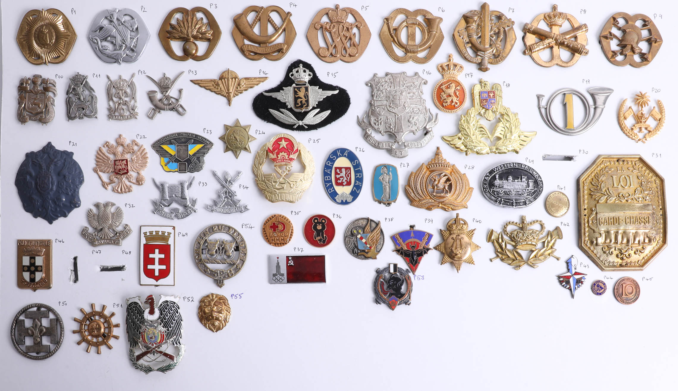 Lot 016 - A collection of approx. 63 German, Austrian, Russian and other foreign military cap badges. Part