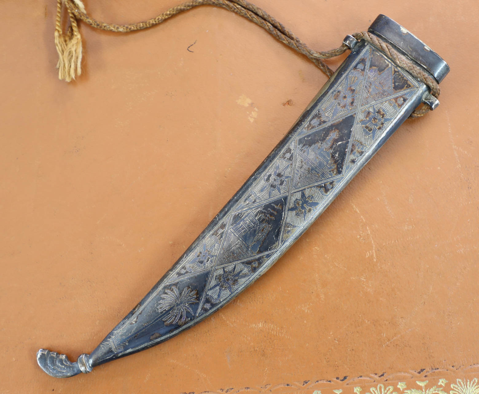 Lot 029 - A dagger in white metal casing, marked 'Mosul 1942'.