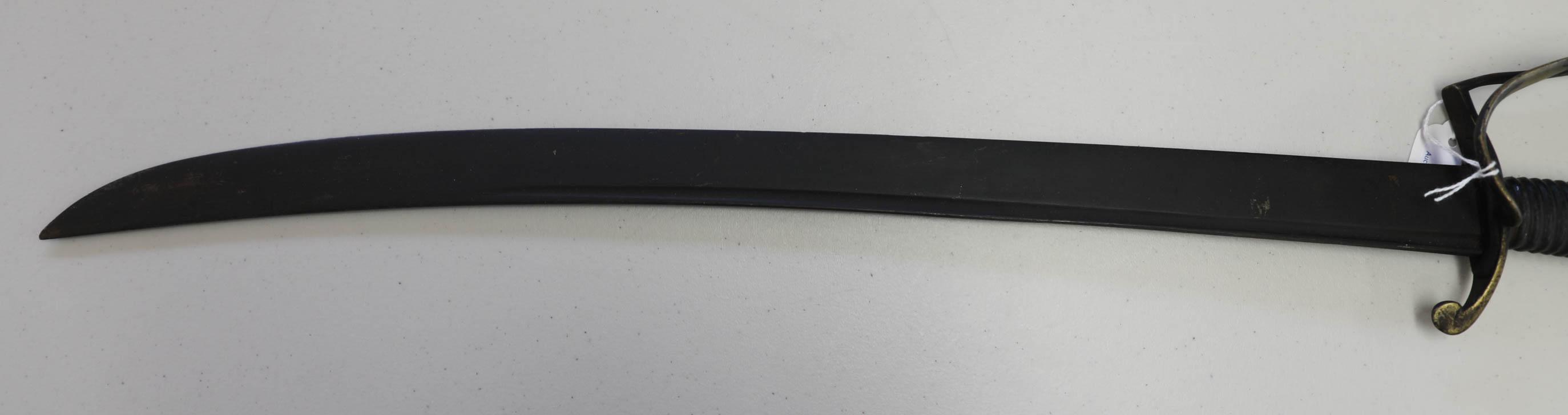 Lot 031 - A Georgian cutlass, the slightly curved blade with single fuller, joining a stirrup and swept bar