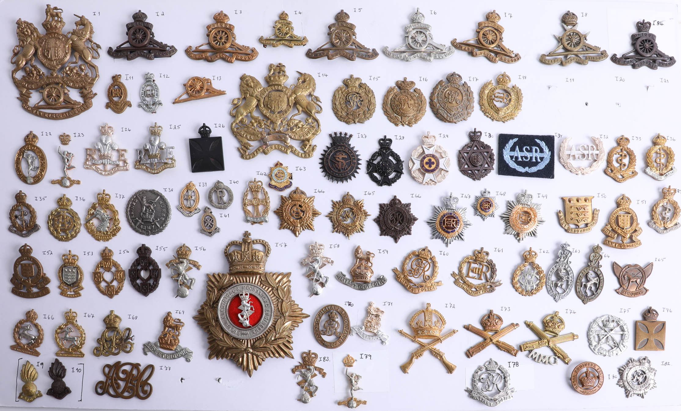Lot 009 - A collection of approx. 90 military cap badges displayed on two sheets including Royal Engineers,