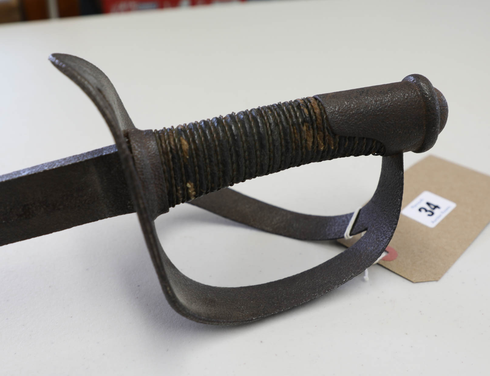 Lot 034 - A 19th century sword with straight blade, basket hilt, length 106cm.