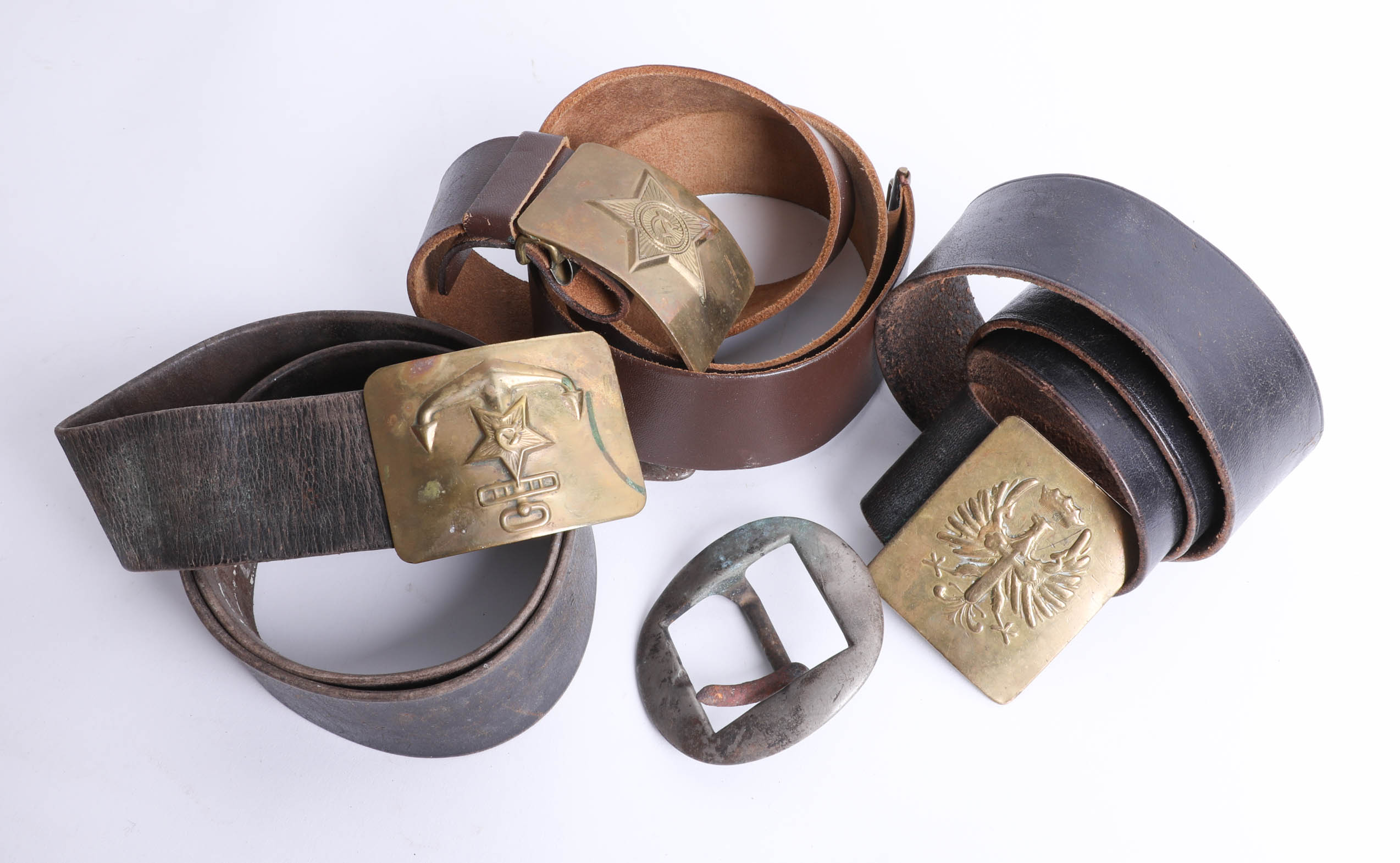 Lot 040 - Three belts, with various military brass buckles and two other loose military buckles. Part of the