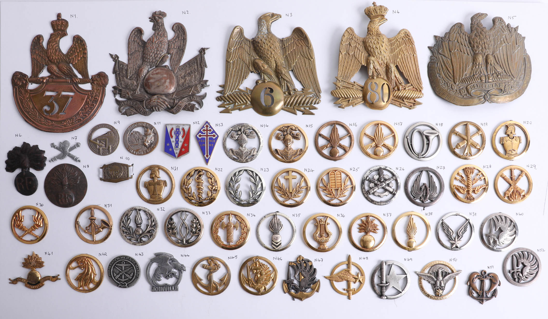 Lot 014 - A collection of approx. 52 military cap badges including 19th century French shako plates also