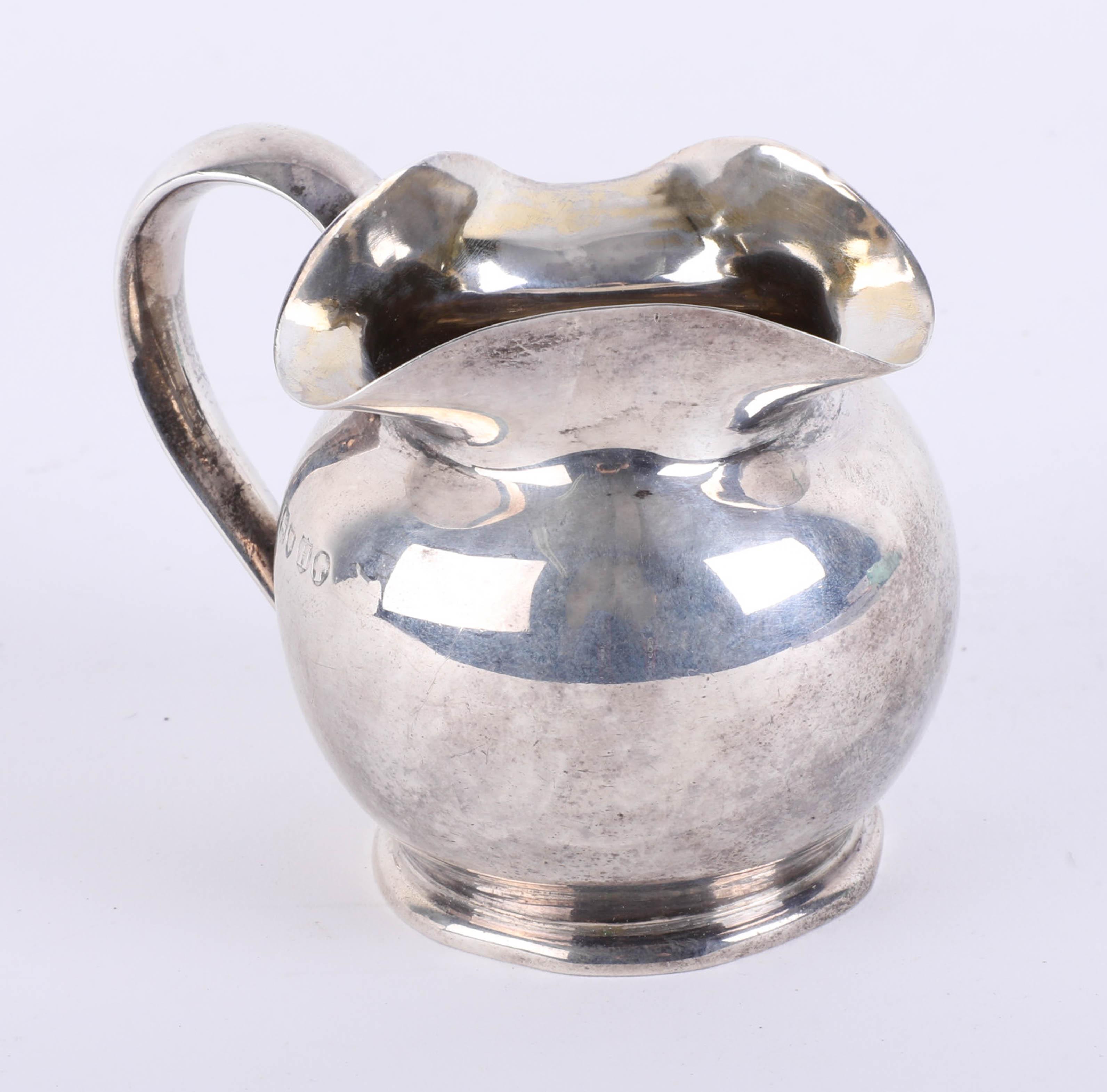 Lot 006 - A silver Victorian cream jug, London, Maker J.A./I.S., total weight 3oz.