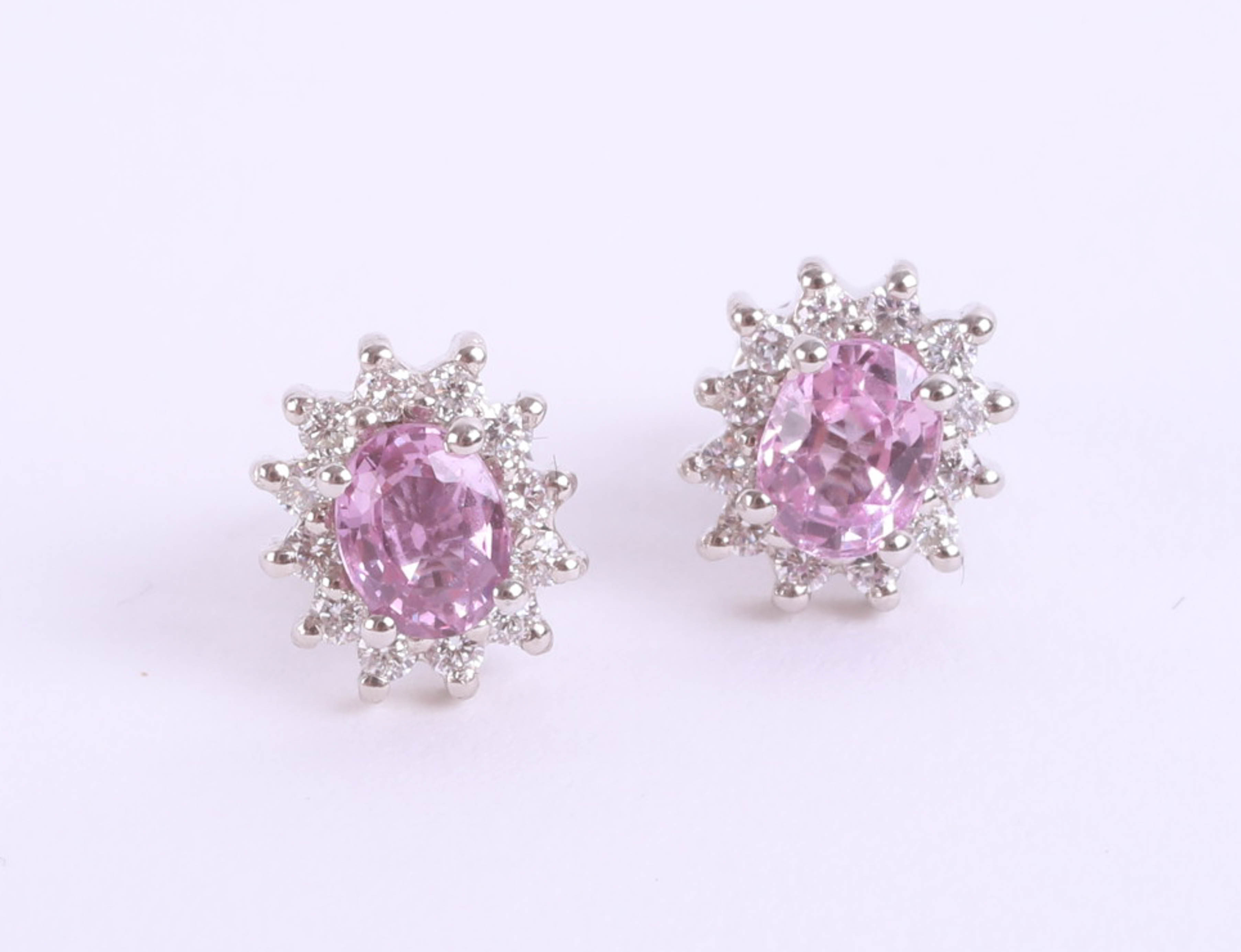 Lot 038 - A pair of 18ct pink sapphire and diamond cluster earrings, in white gold.