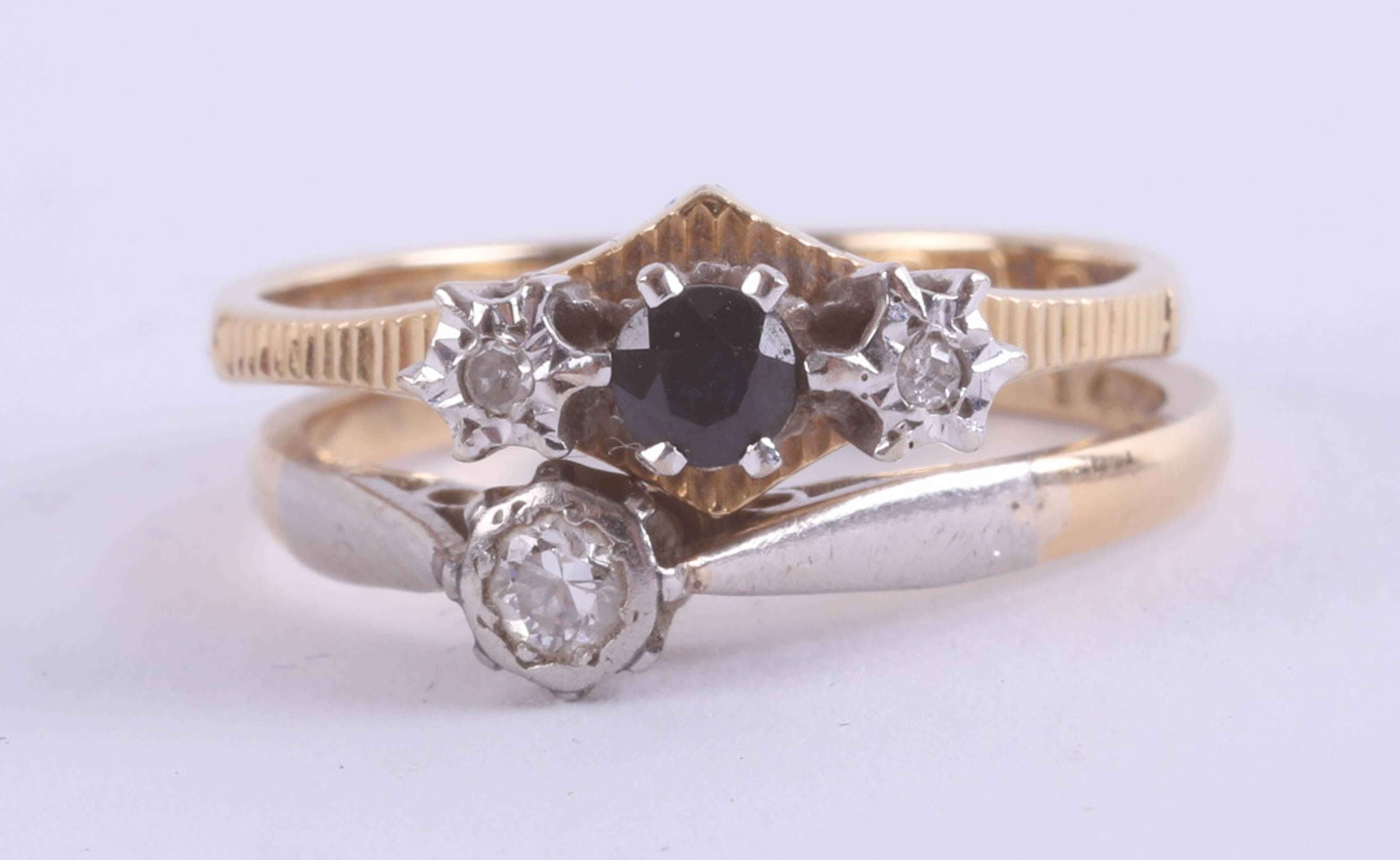 Lot 022 - Two 18ct rings set with small sapphires and diamonds, total weight approximately 4.9g.