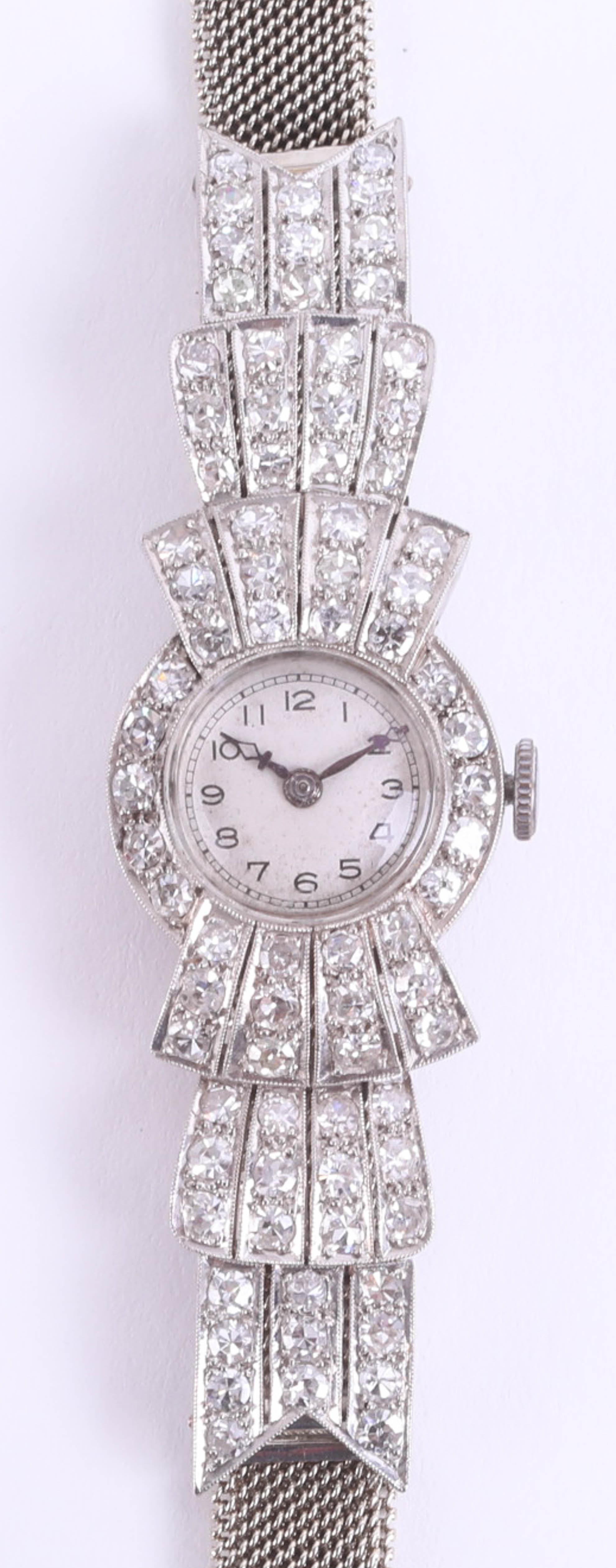Lot 029 - An Art Deco diamond cocktail watch, the circular dial with Arabic numeral, in possibly its
