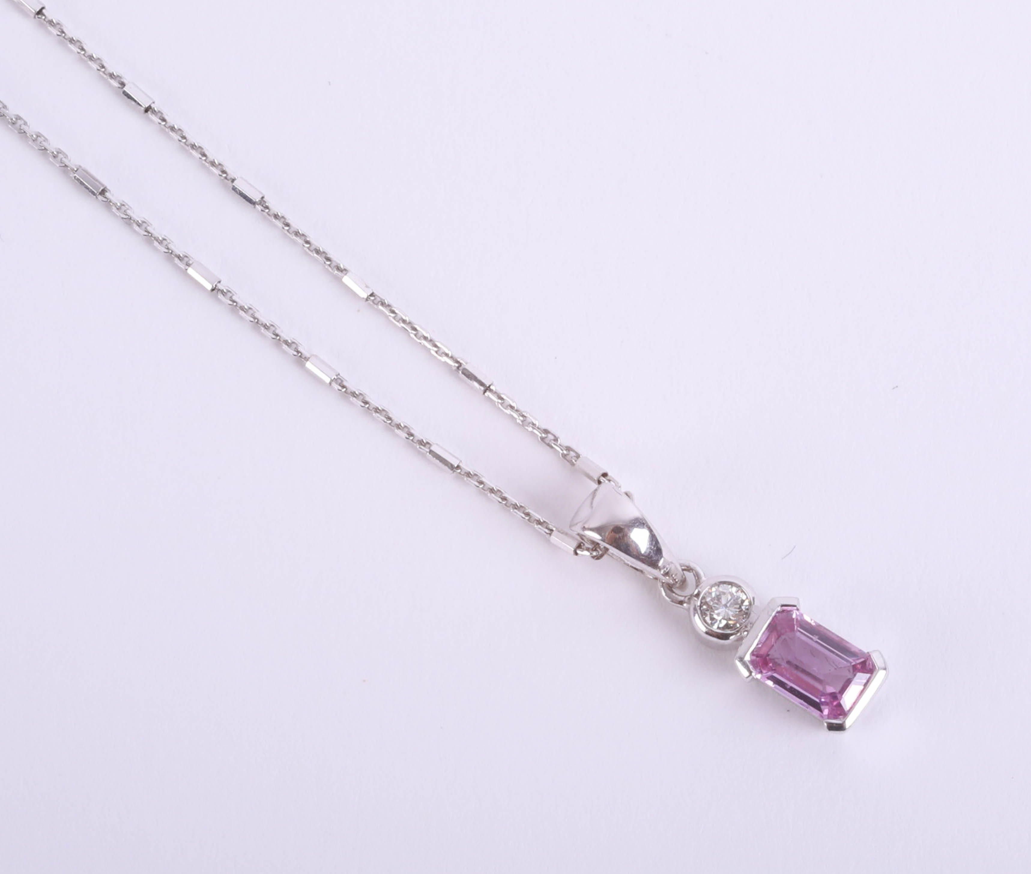 Lot 039 - An 18ct pink sapphire and diamond pendant, in white gold.