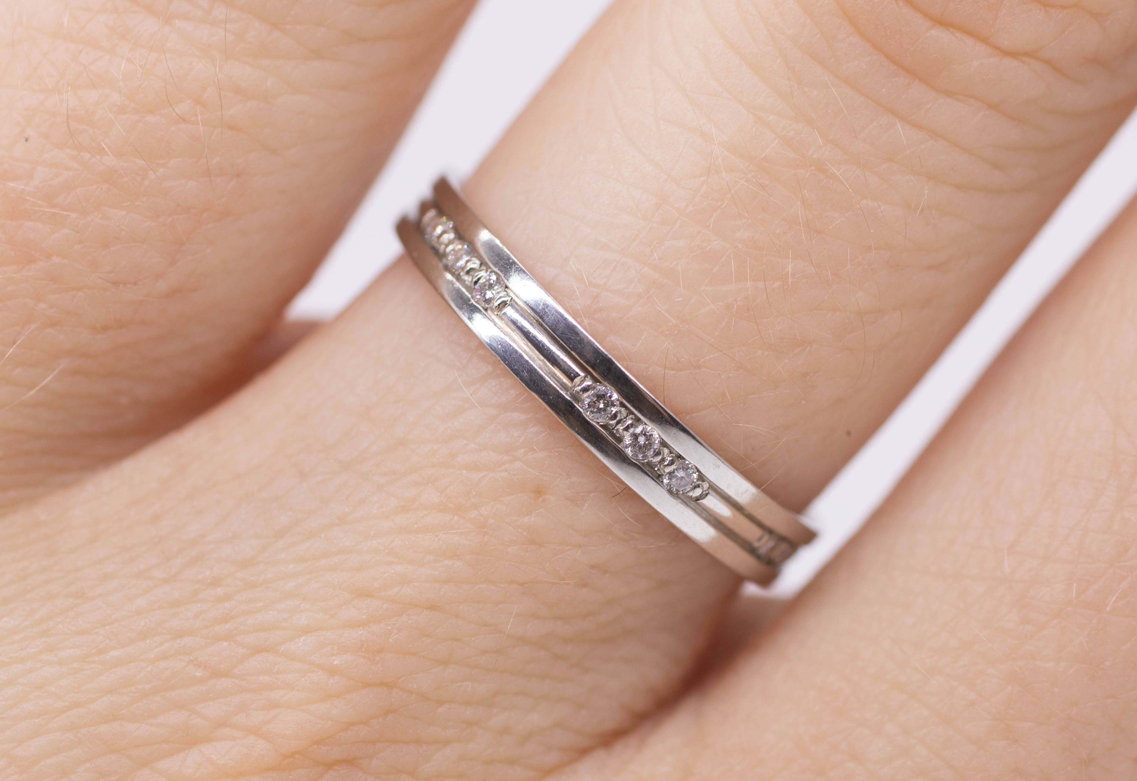 A platinum and diamond set band ring, size N. - Image 2 of 4