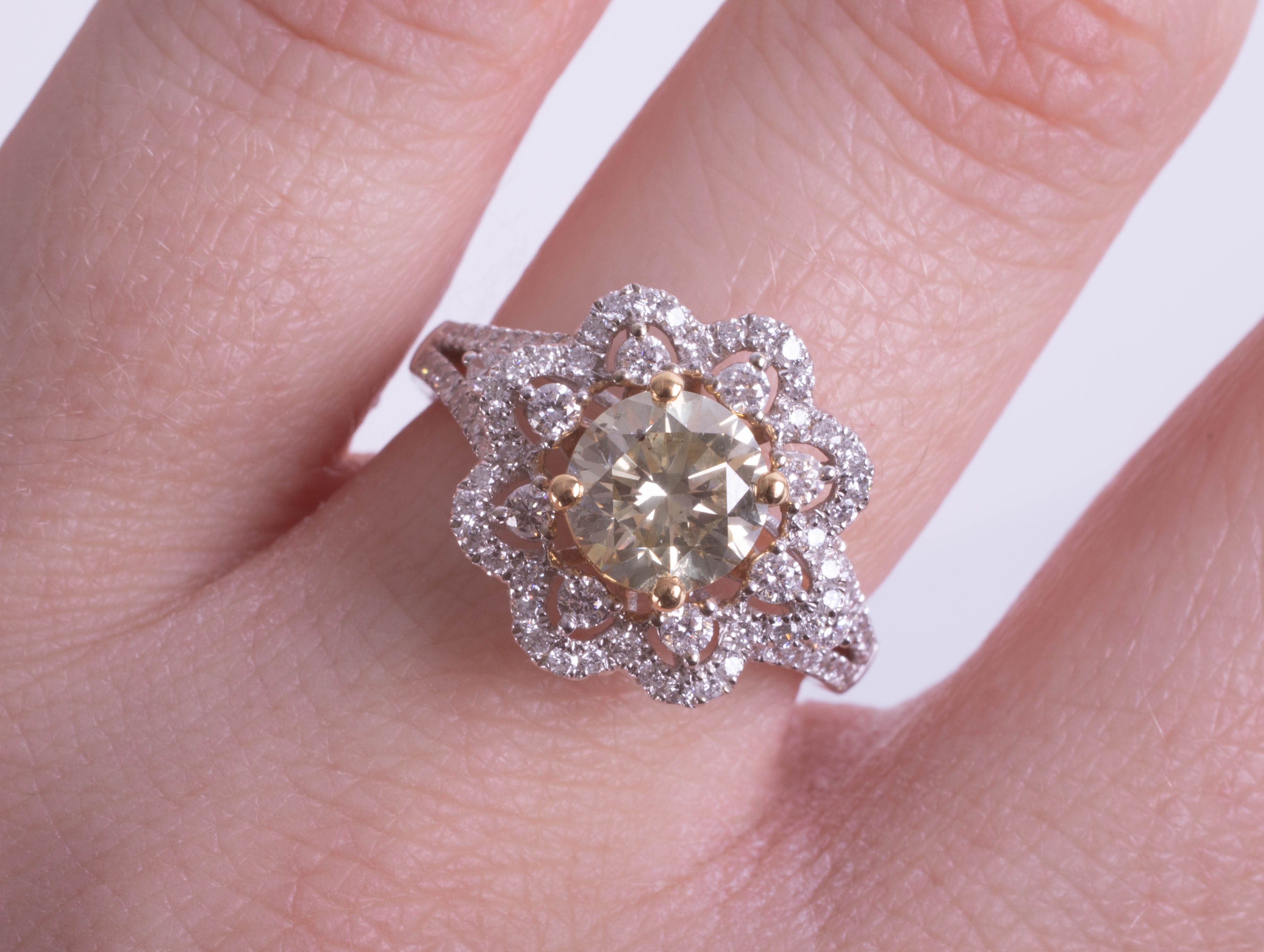 An 18ct white gold daisy-style, ornate dress ring set with a central fancy RBC diamond (1.36ct) - Image 2 of 2