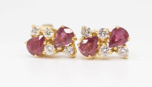 A pair of fancy 18ct ruby and diamond set earrings each comprising six stones.
