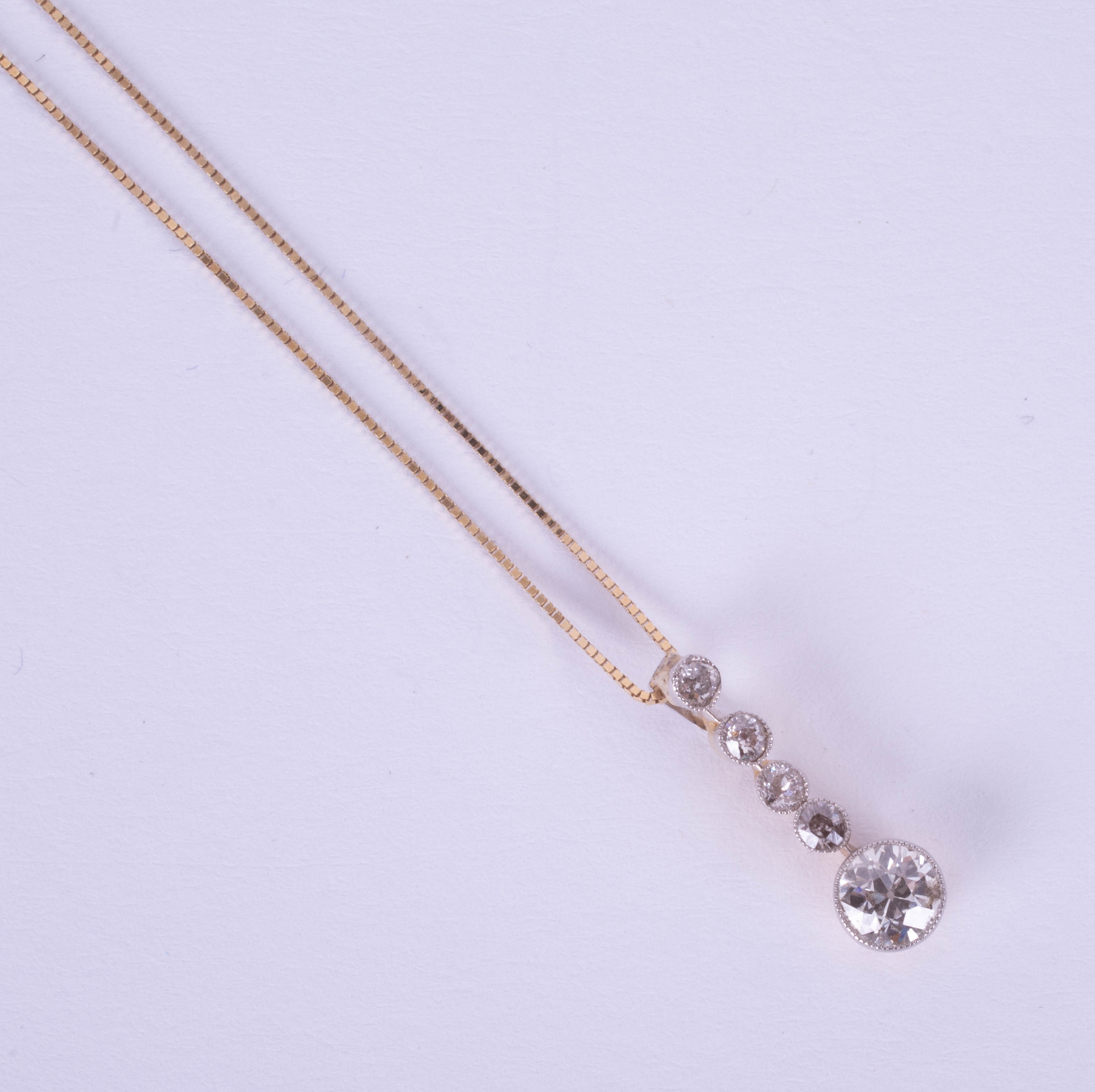 A five stone diamond pendant necklace, early 20th century, on fine chain.
