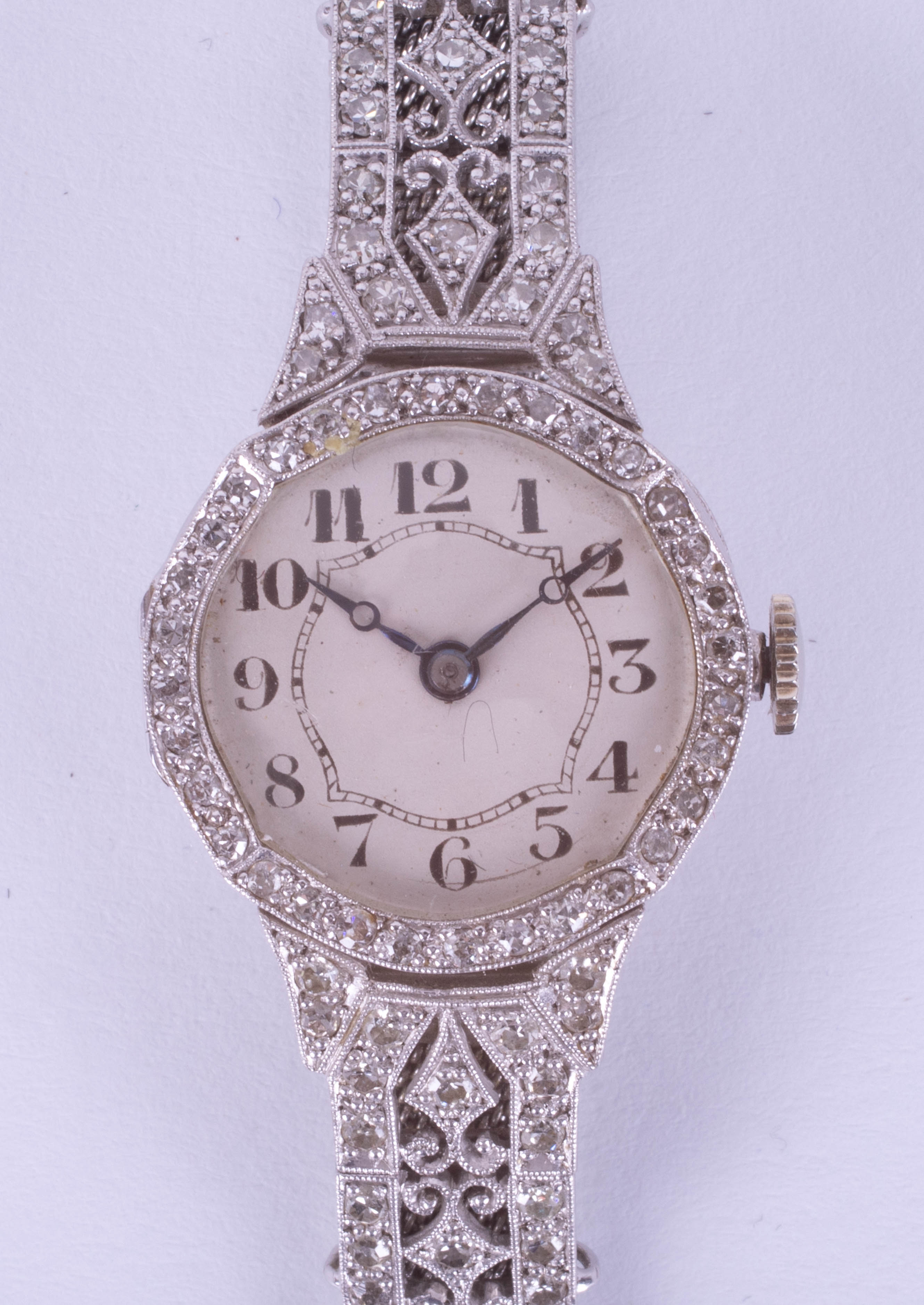 An 18ct diamond set cocktail watch with mesh bracelet, approximately 23.76g, the back case