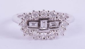 An 18ct white gold diamond 'boat' cluster ring, diamond weight approx 0.50ct, ring size K.