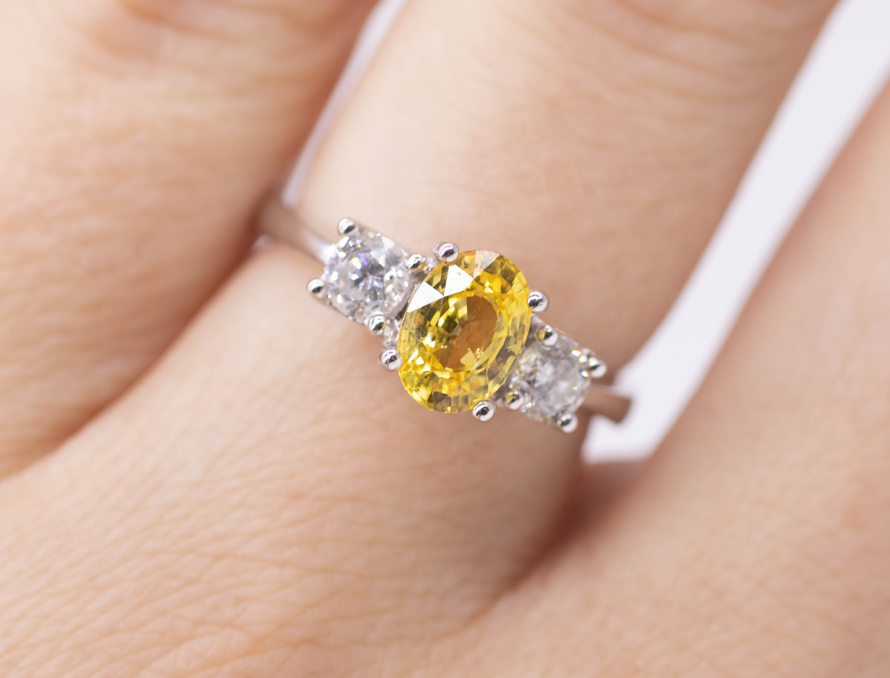 An 18ct yellow sapphire and diamond set three stone ring, size L. - Image 2 of 2