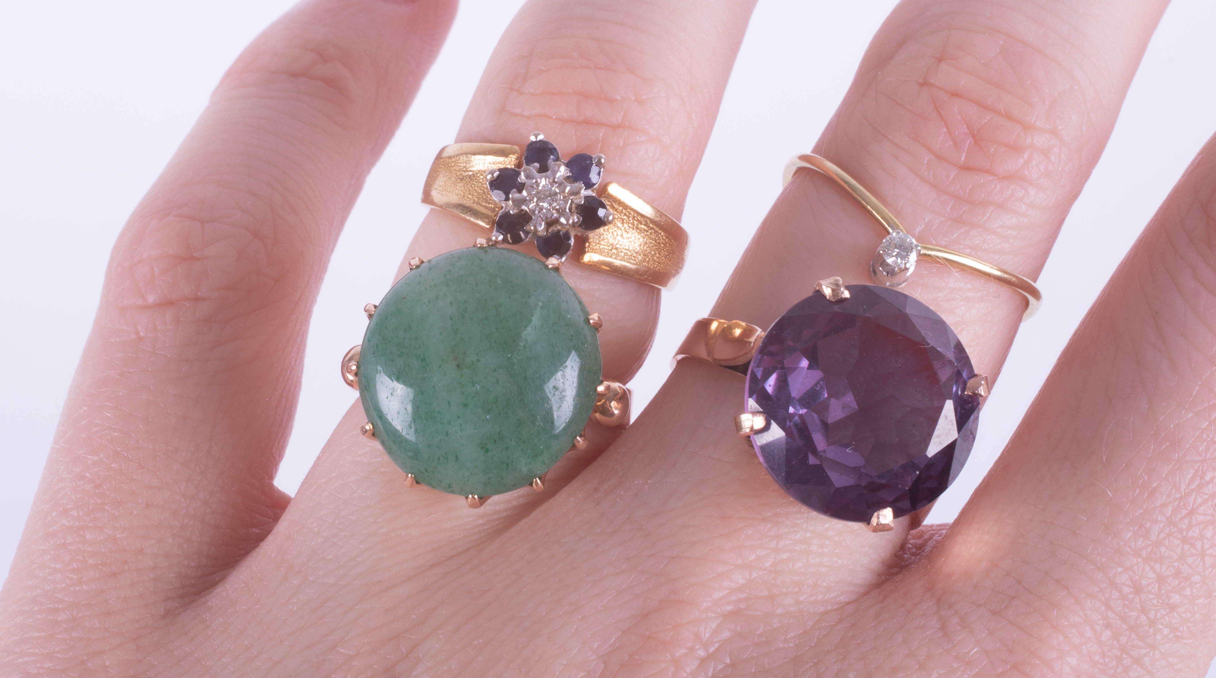 A large amethyst ring, set in gold? indistinct marks, size K, a jade set dress ring, size K, a small