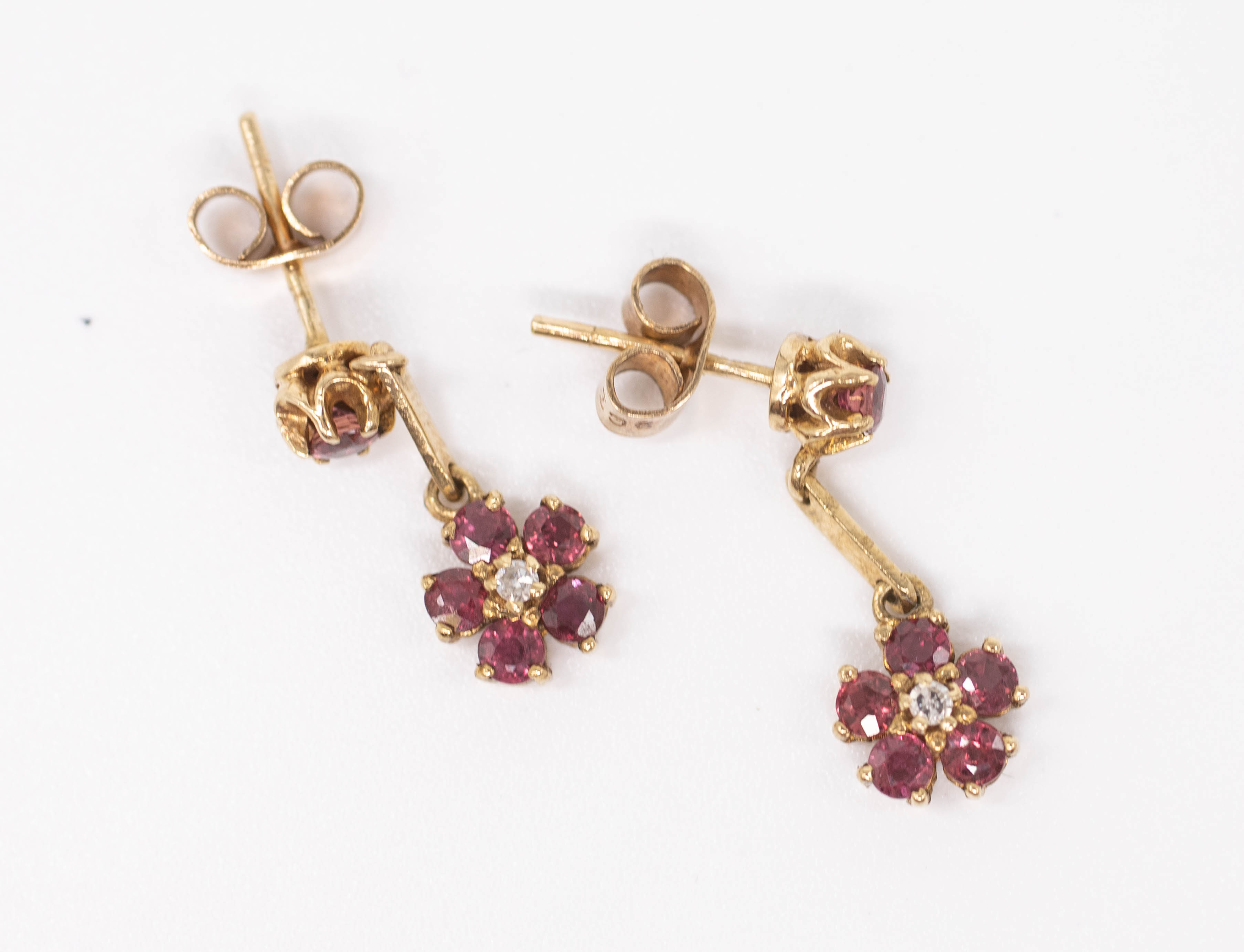 A pair of 9ct ruby and diamond set drop earrings.