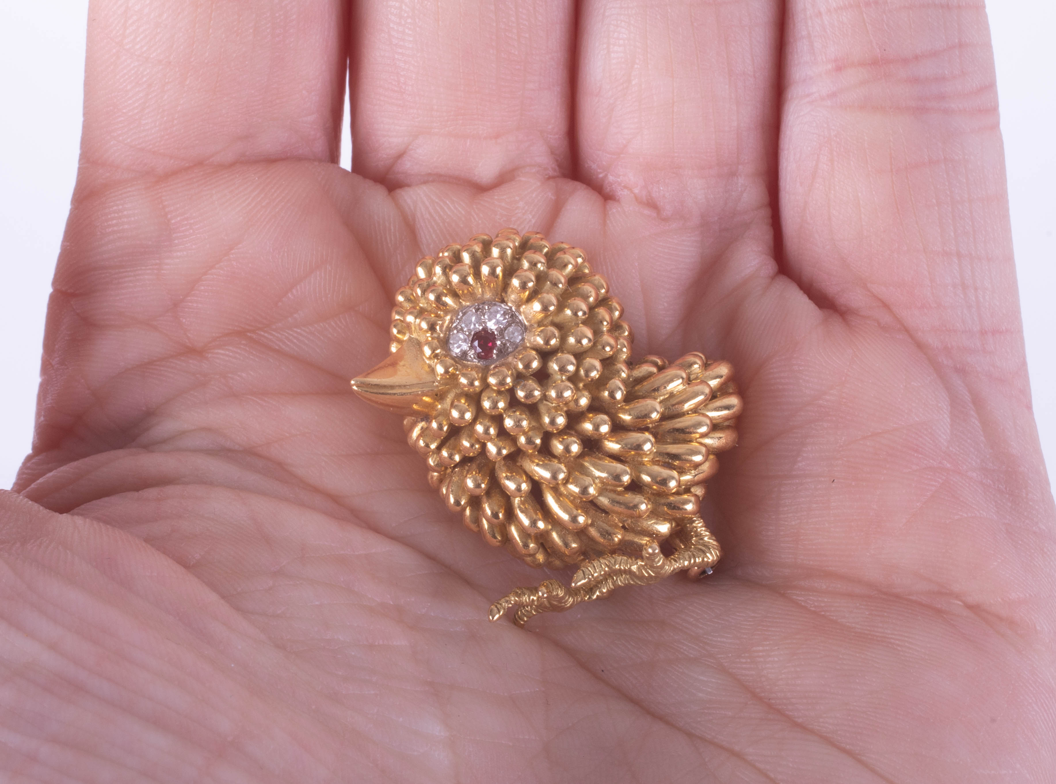 An 18ct gold, ruby and diamond brooch, designed as a chick, the eye mounted with a ruby and with - Image 2 of 2