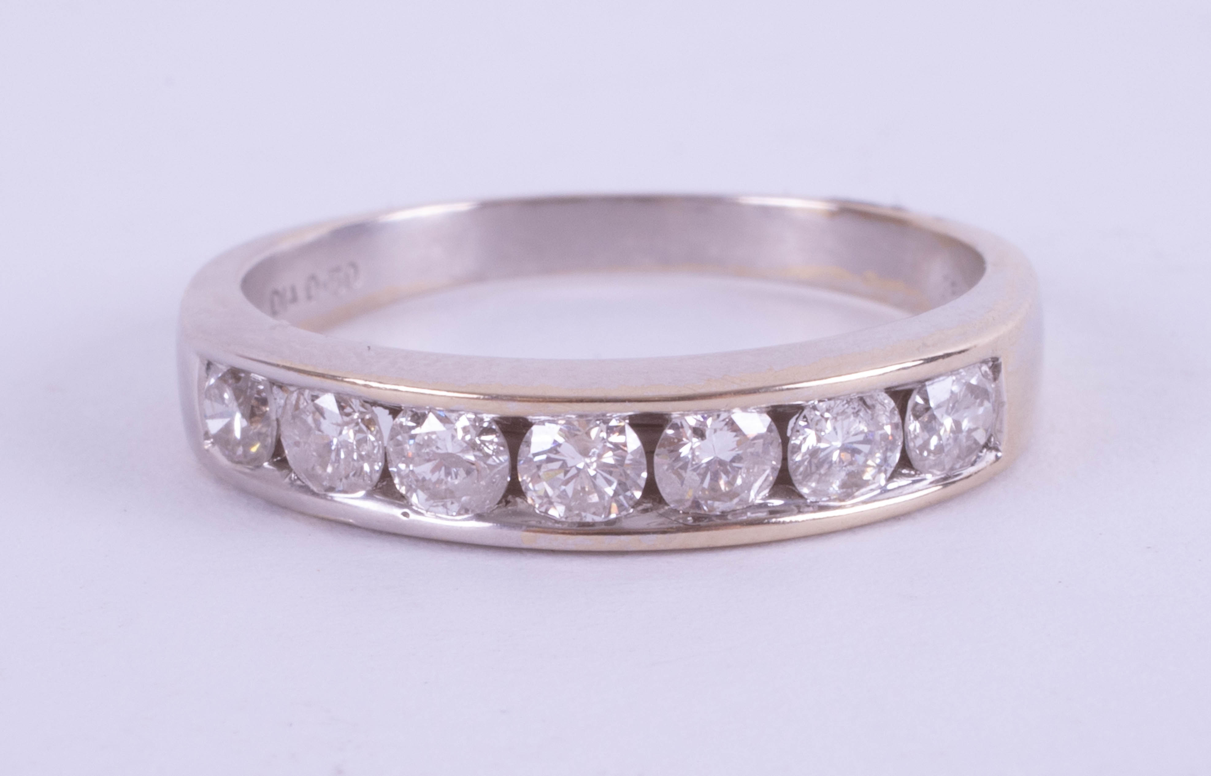An 18ct white gold half band eternity ring, approx. 0.50ct, ring size J.
