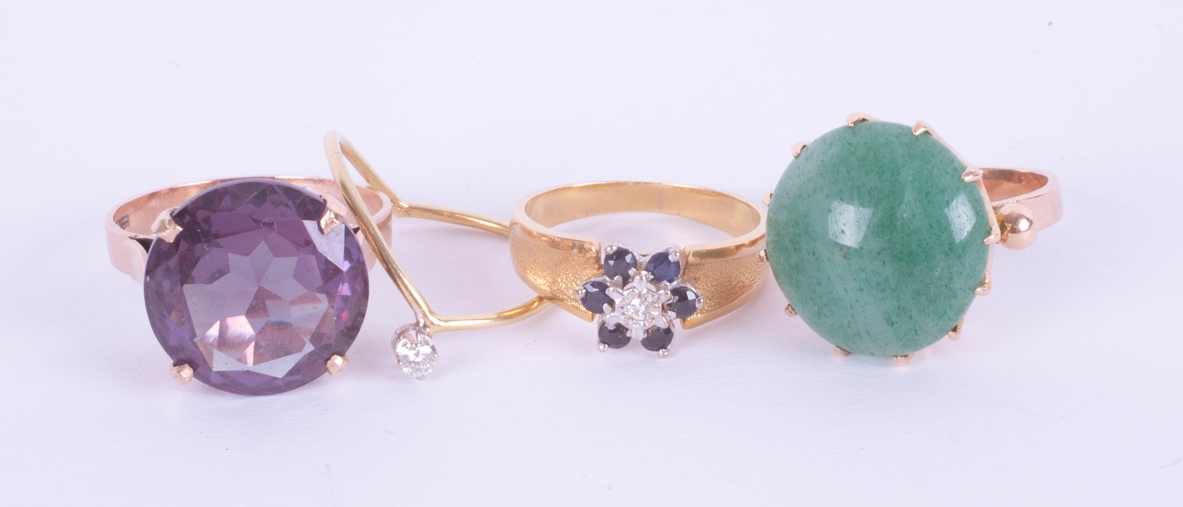 A large amethyst ring, set in gold? indistinct marks, size K, a jade set dress ring, size K, a small - Image 2 of 2