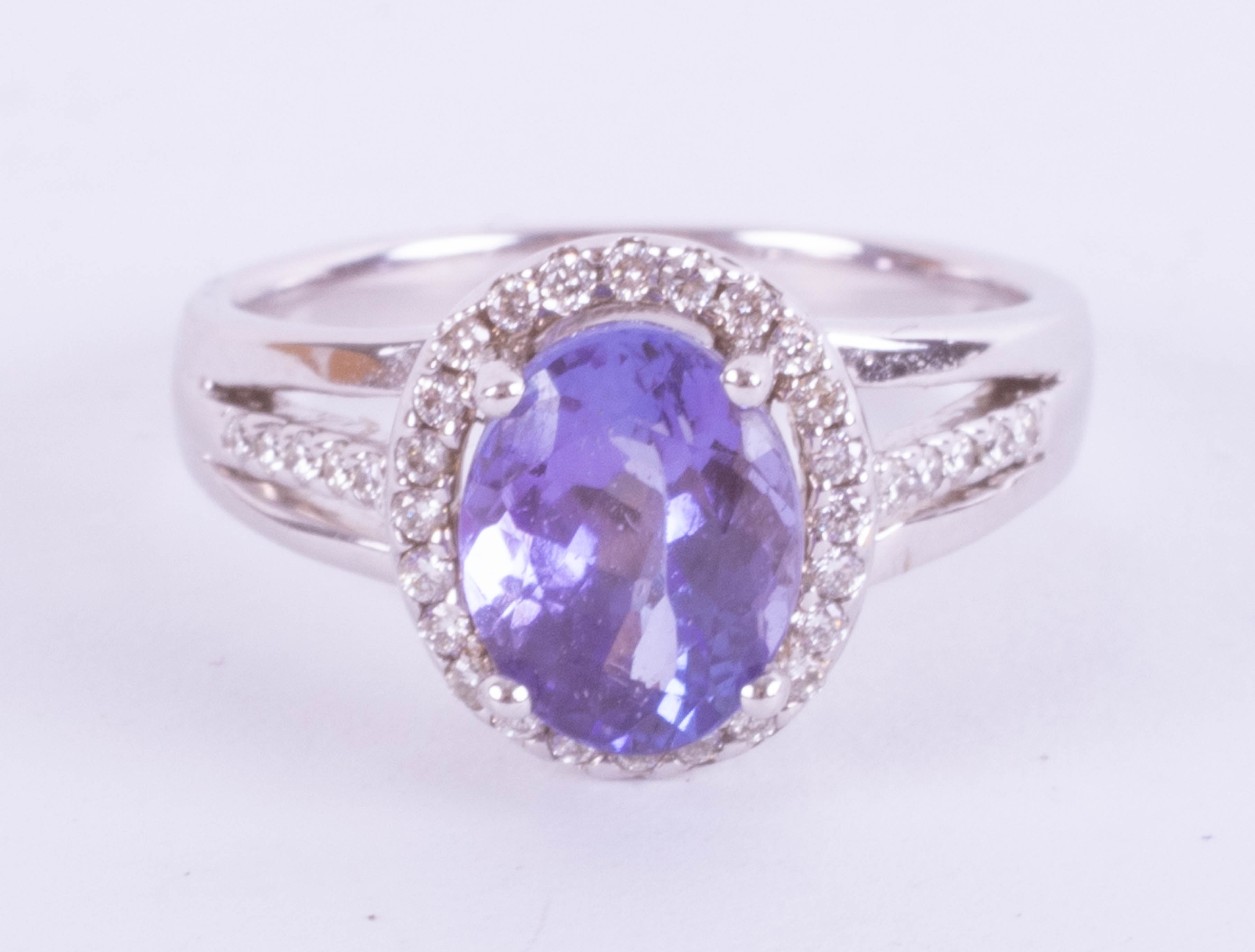 An 18ct white gold diamond and Tanzanite ring approx. 2.75ct, ring size N.
