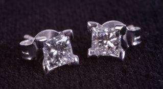 A pair of 18ct white gold 4 claw-set princess cut diamond studs, boxed. Diamonds 0.74ct.