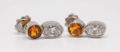 A pair 18ct diamond and fire opal set earrings in white gold.