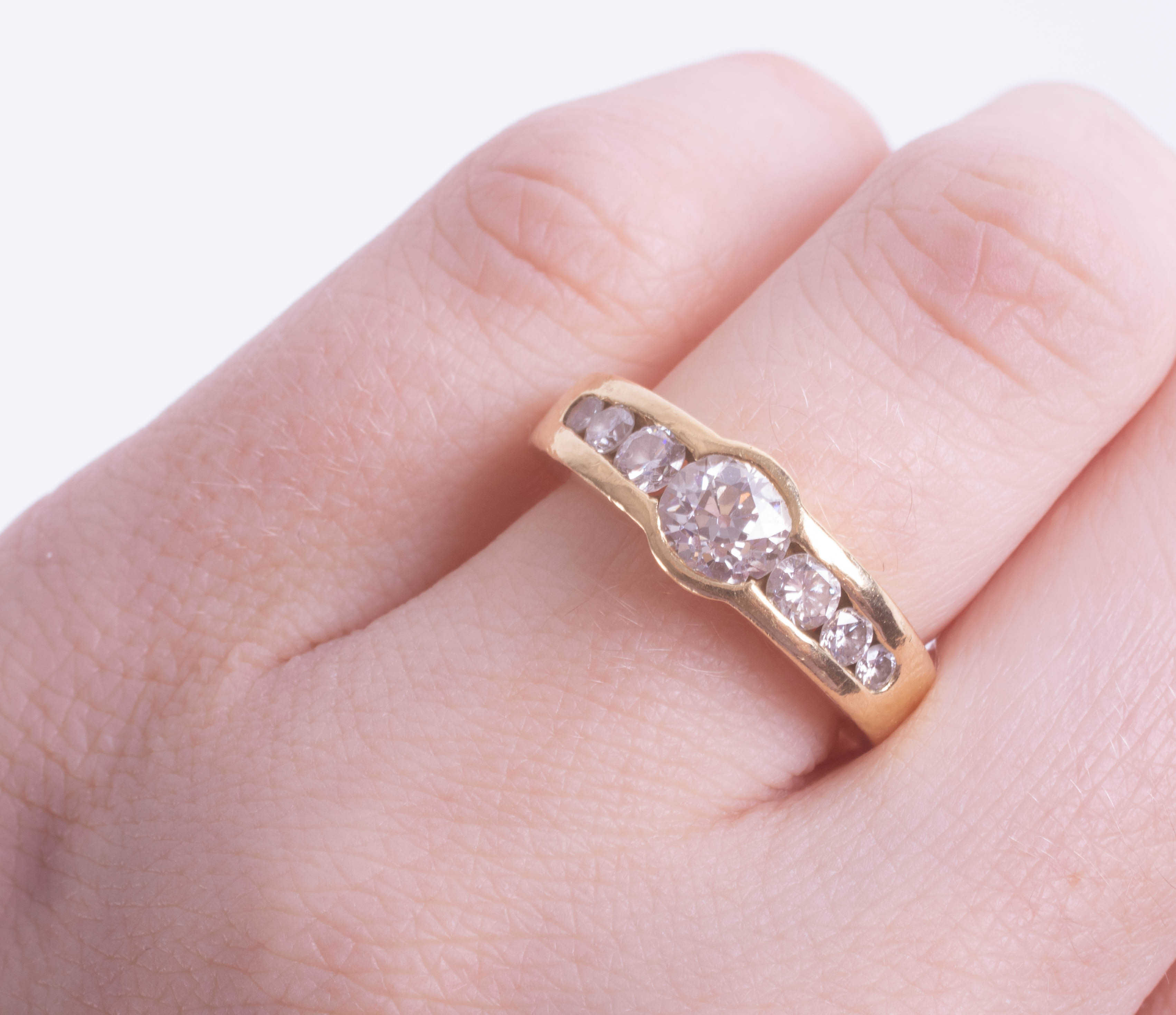 An 18ct diamond set seven stone ring, the central diamond approximately 0.80ct, with a copy of a - Image 2 of 2