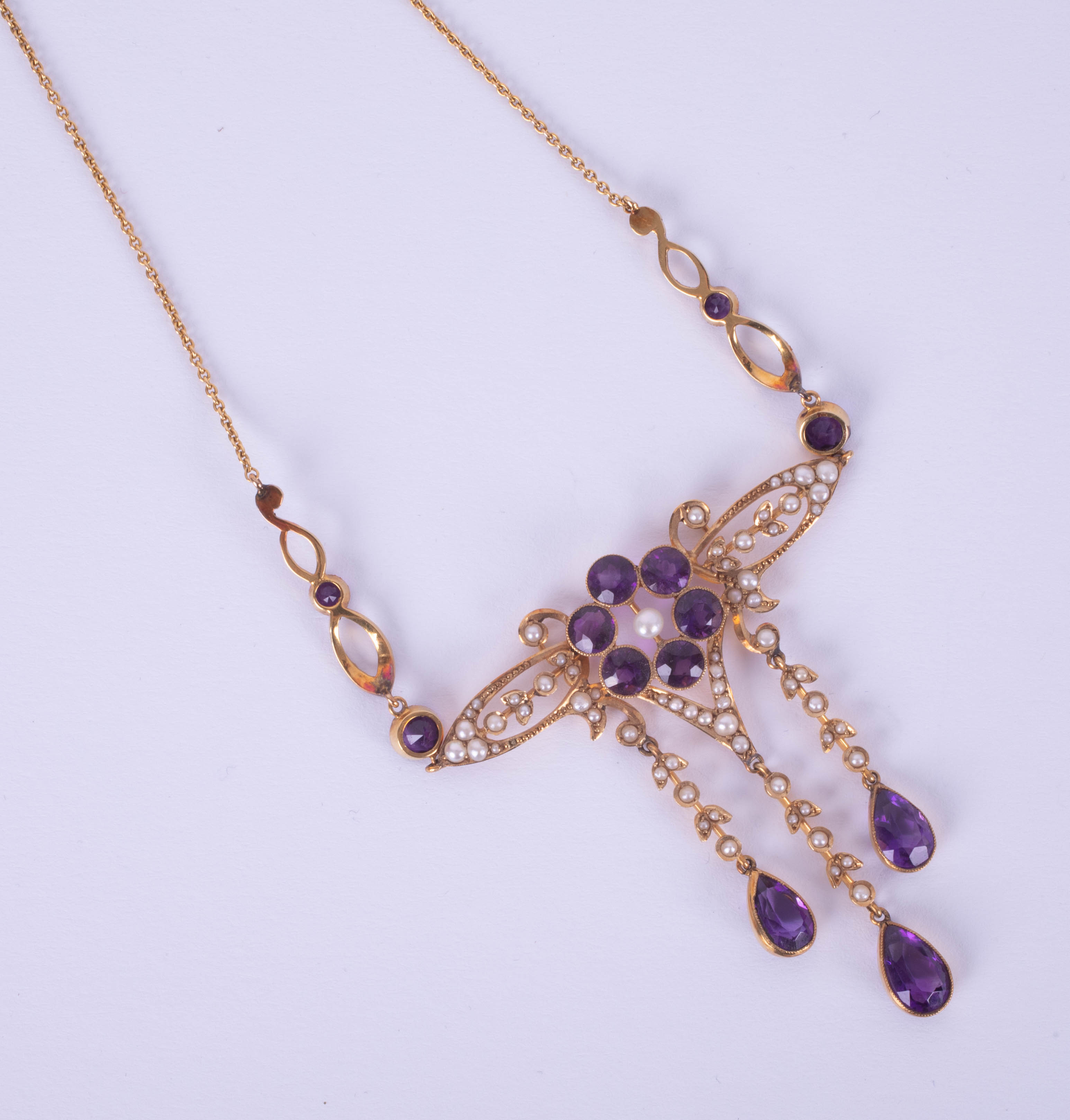 An antique amethyst and pearl set necklace in possibly original box marked 'Kemp Wilcox,