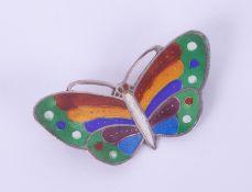 A silver and enamel butterfly brooch, span 44mm.