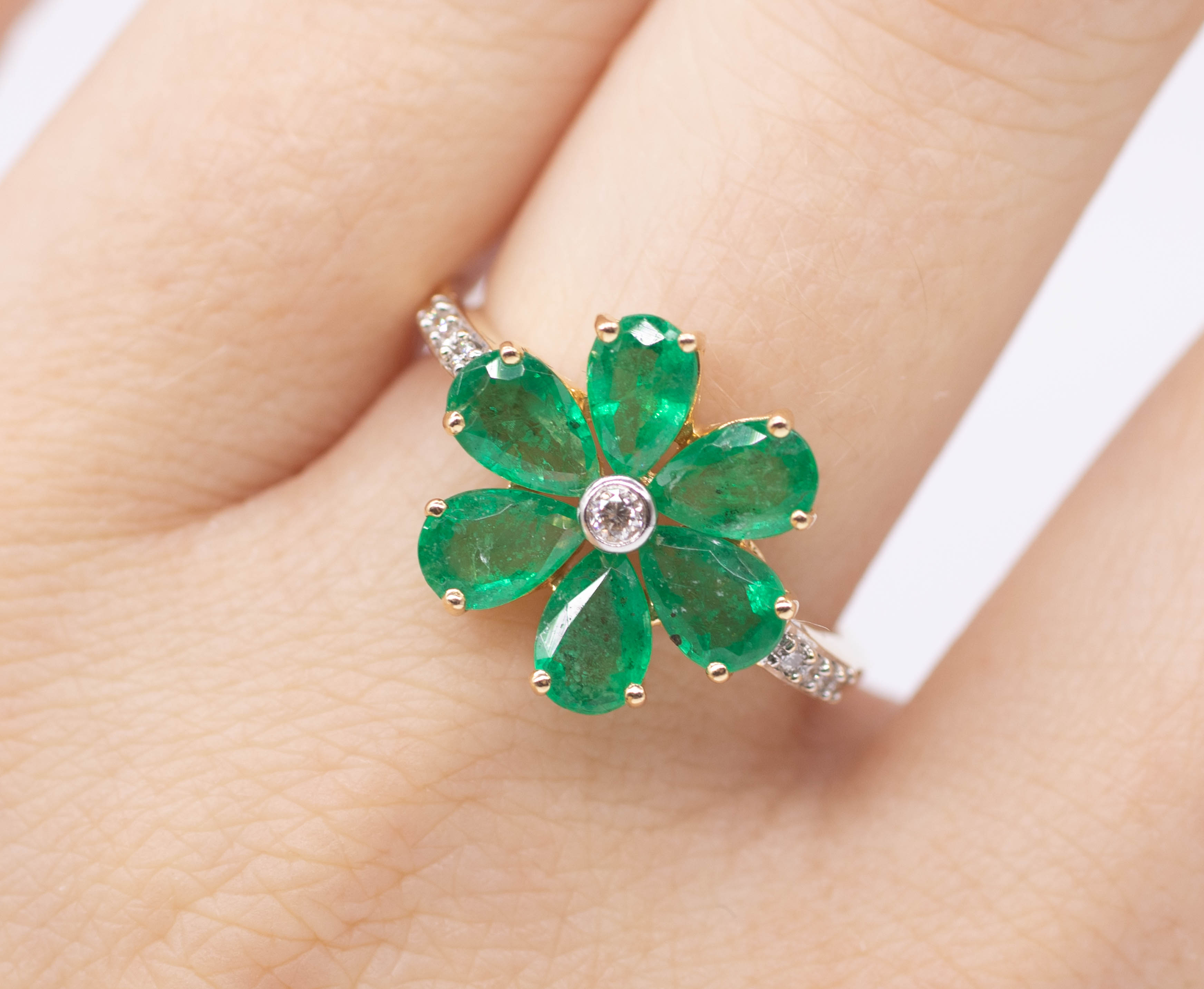 An 18ct emerald and diamond cluster ring in the form of a flower head set in yellow gold, size O. - Image 2 of 2