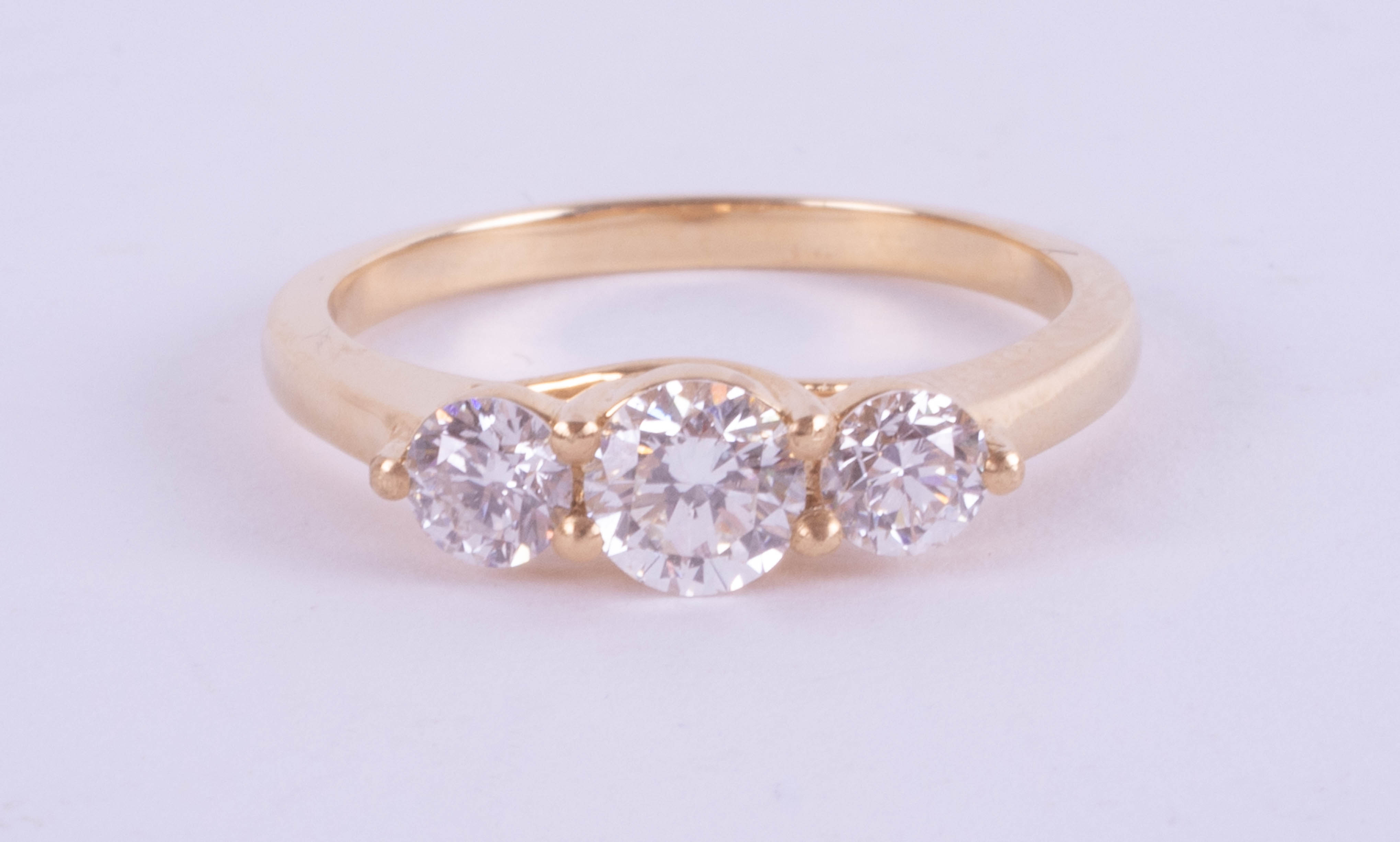 An 18ct yellow gold trilogy ring approx. 0.80ct, estimated colour E, clarity SI1, ring size M.